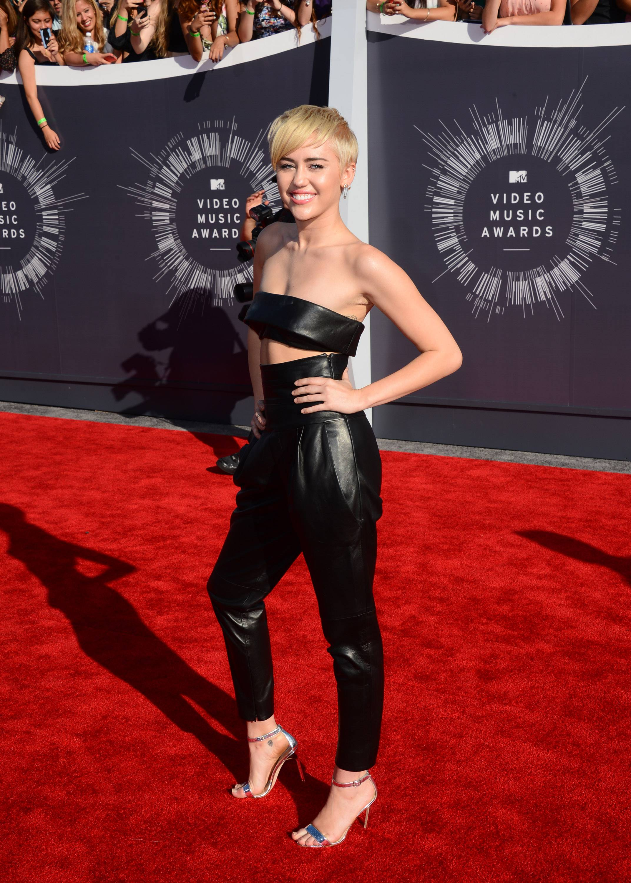 MEH: This outfit is downright subued for Miley Cyrus. Translation: boring.