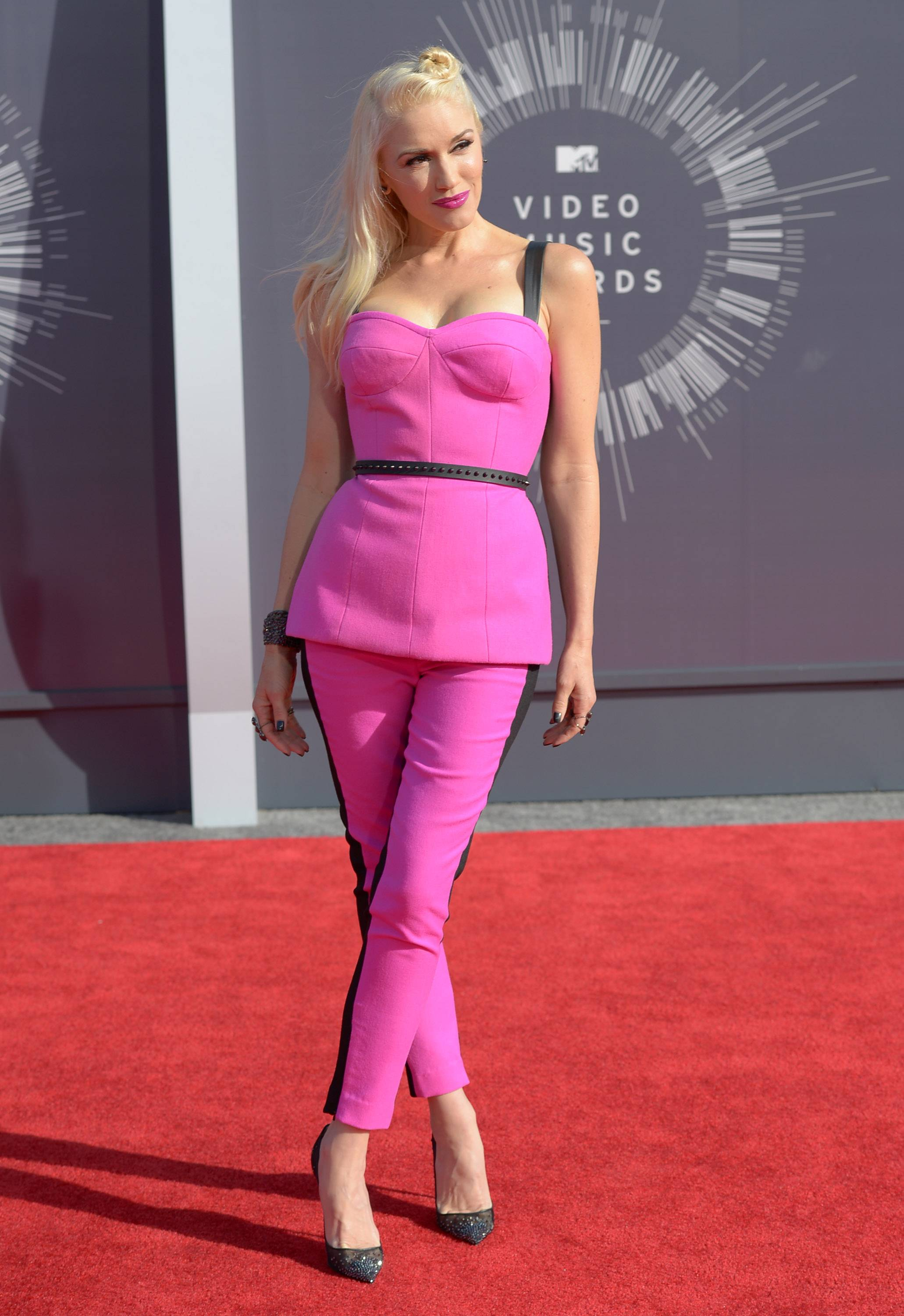 TIE: Diggin' the hot pink, not diggin' the hair on Gwen Stefani.