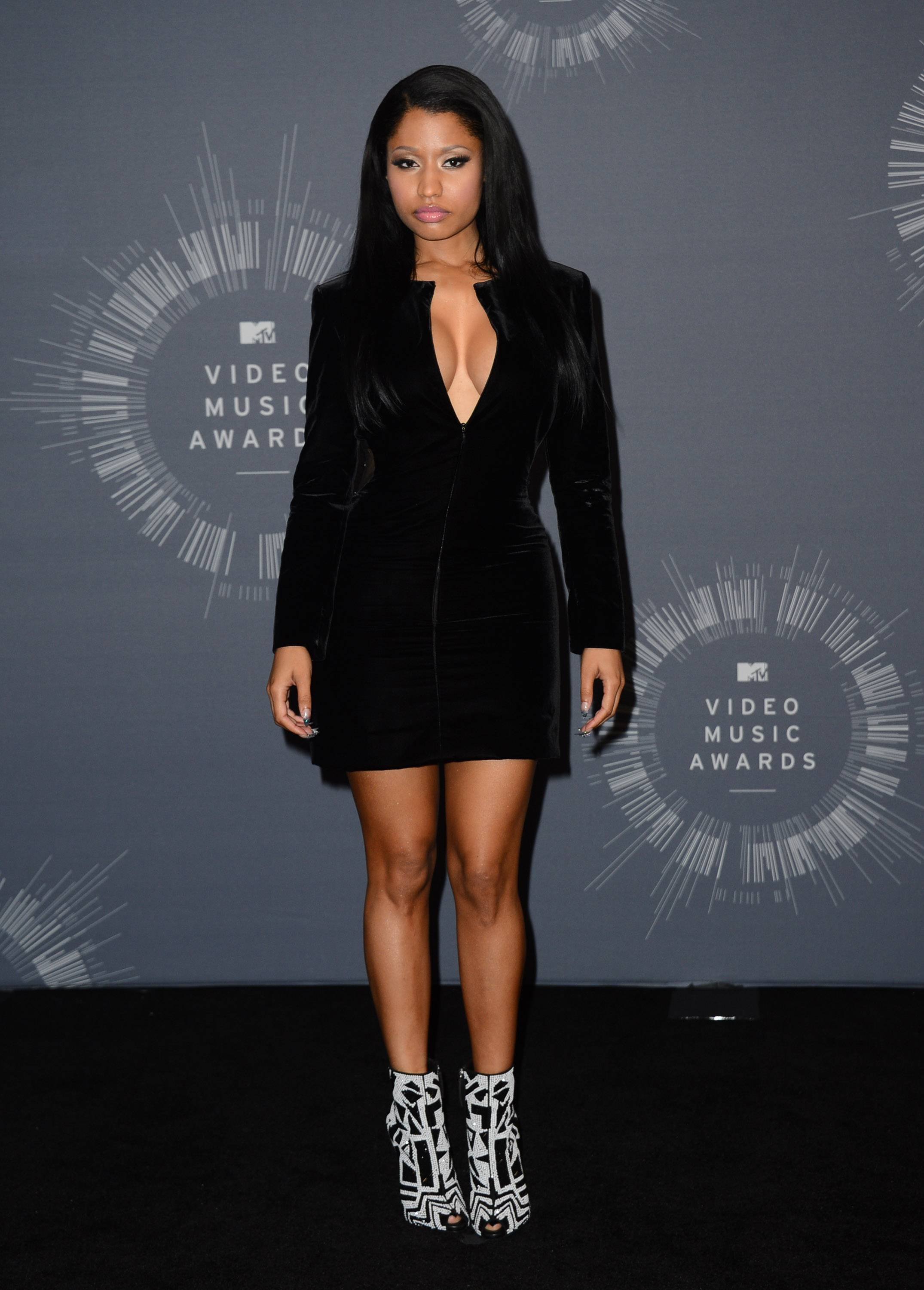 BEST: Nicki Minaj manages to redeem herself in this little black dress that fits her to a T and even offers a bit of pop with her graphic print booties.