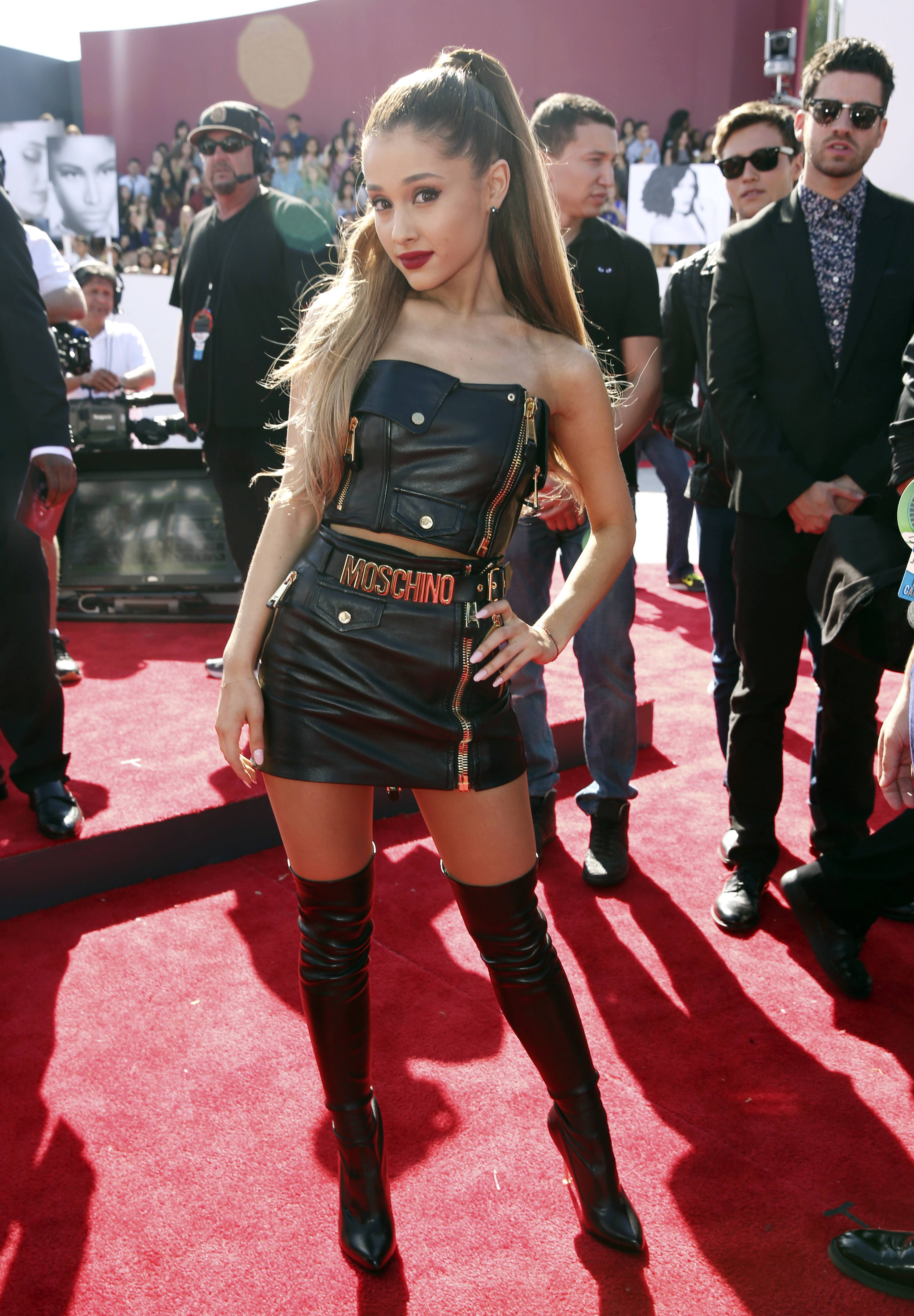 WORST: Ariana Grande just disappears in this bad idea of an outfit. Next time follow Coco Chanel's advice and take off one thing (that horrible belt) before you leave the house.