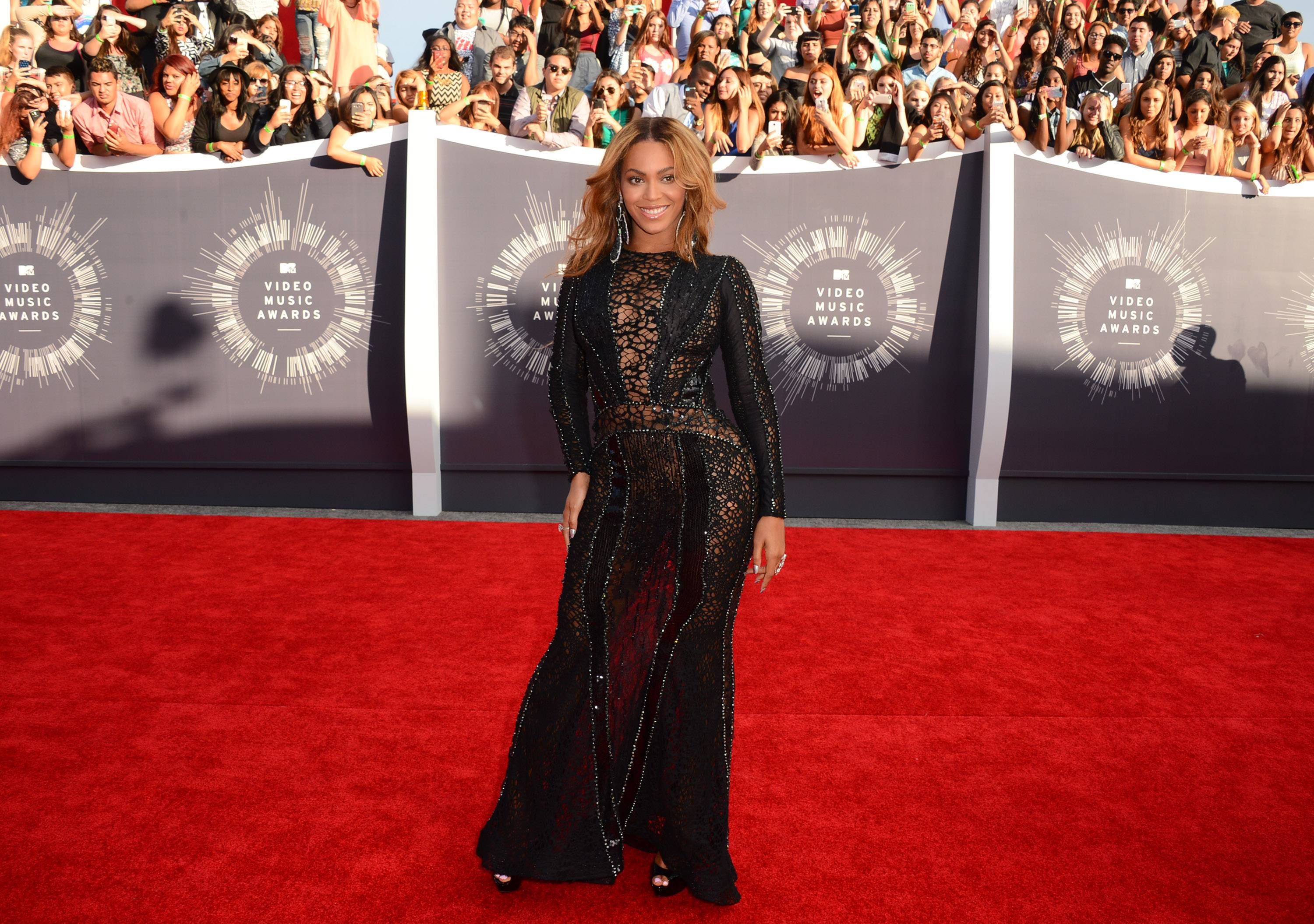 BEST: Queen Beyonce manages to turn basic black on its head in this beautiful gown.