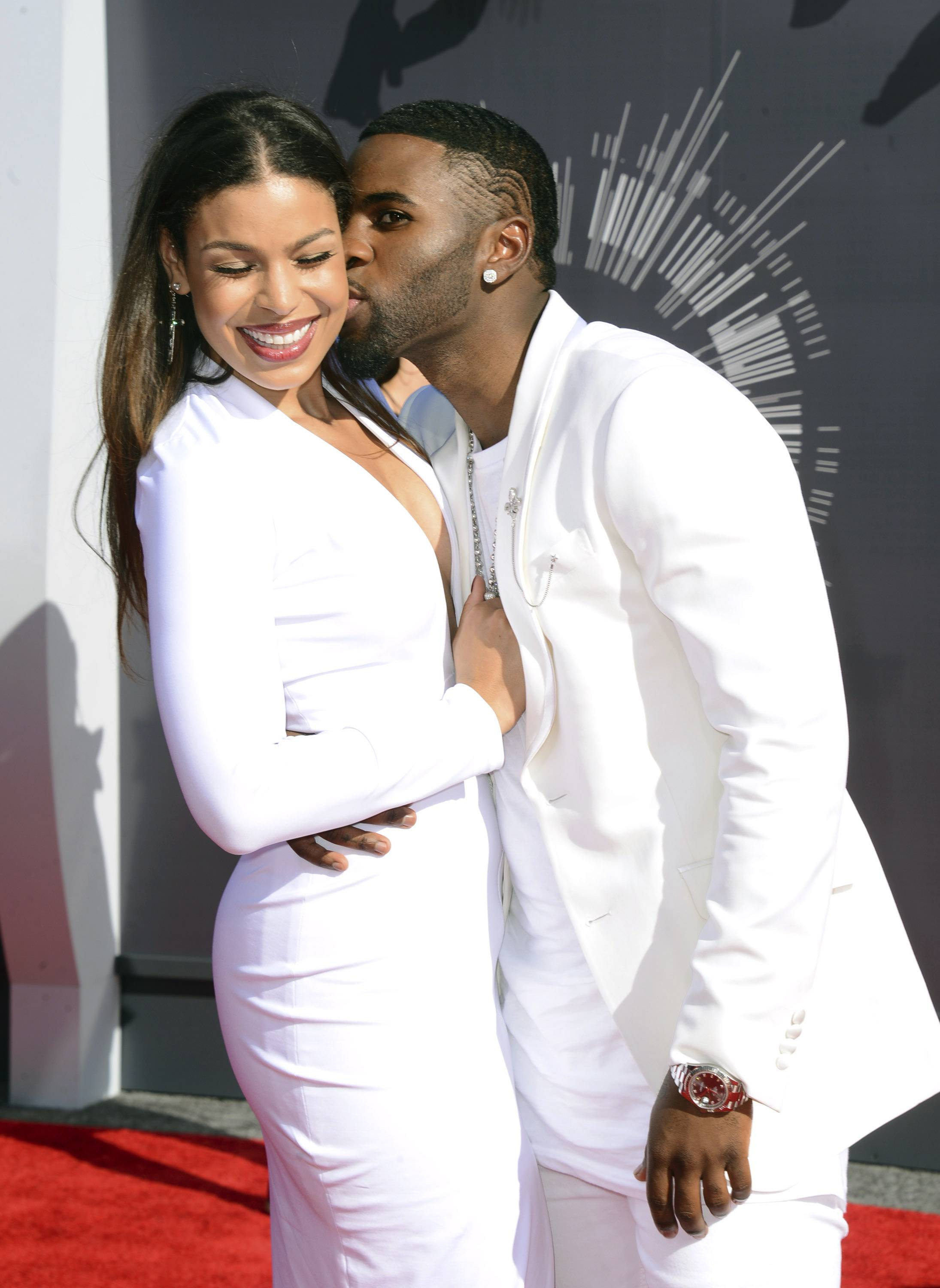 Jordin Sparks, left, and Jason Derulo offer up some sweet PDA on the red carpet at the VMAs.