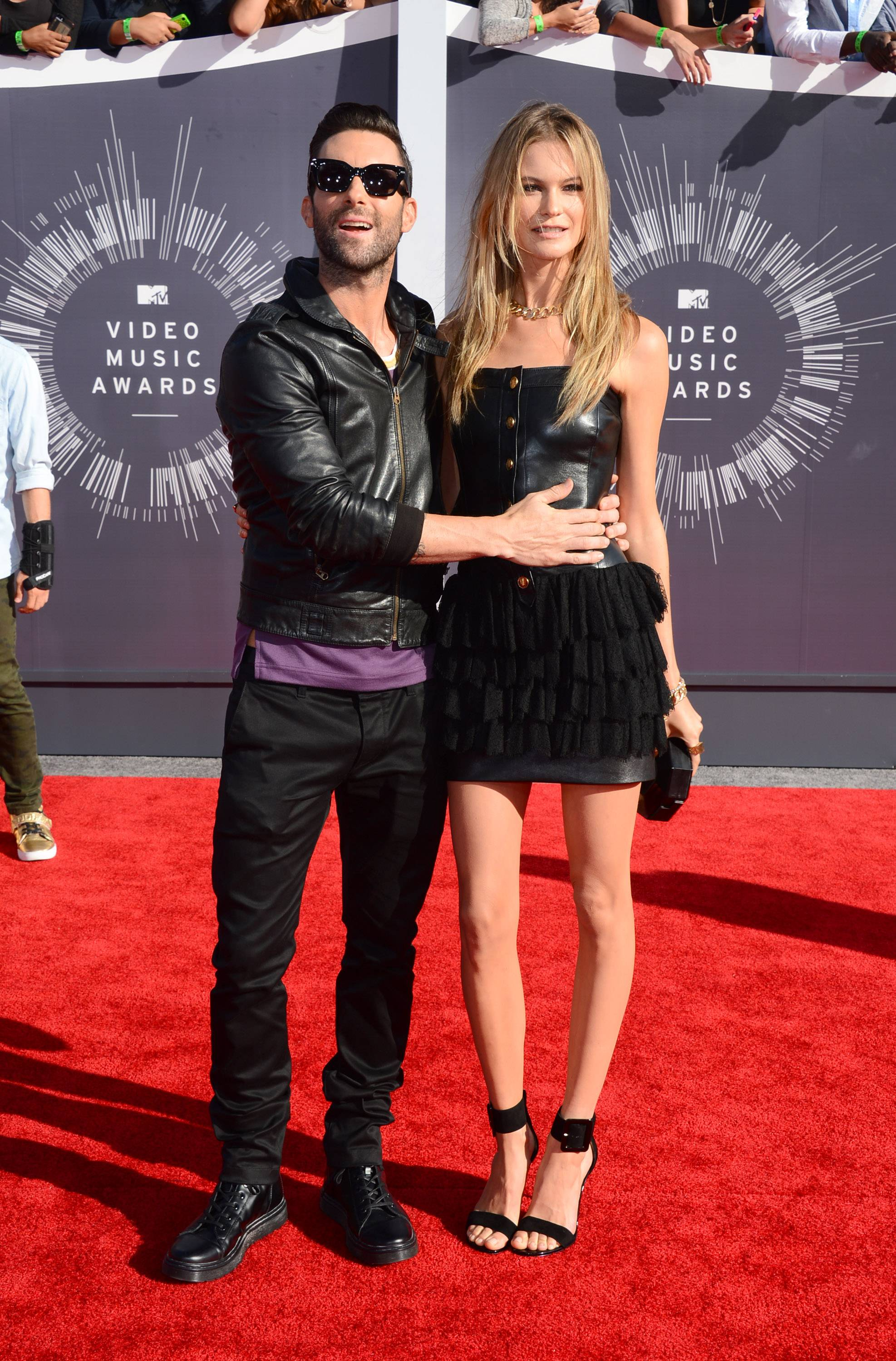 Adam Levine, left, and Behati Prinsloo arrive at the MTV Video Music Awards.