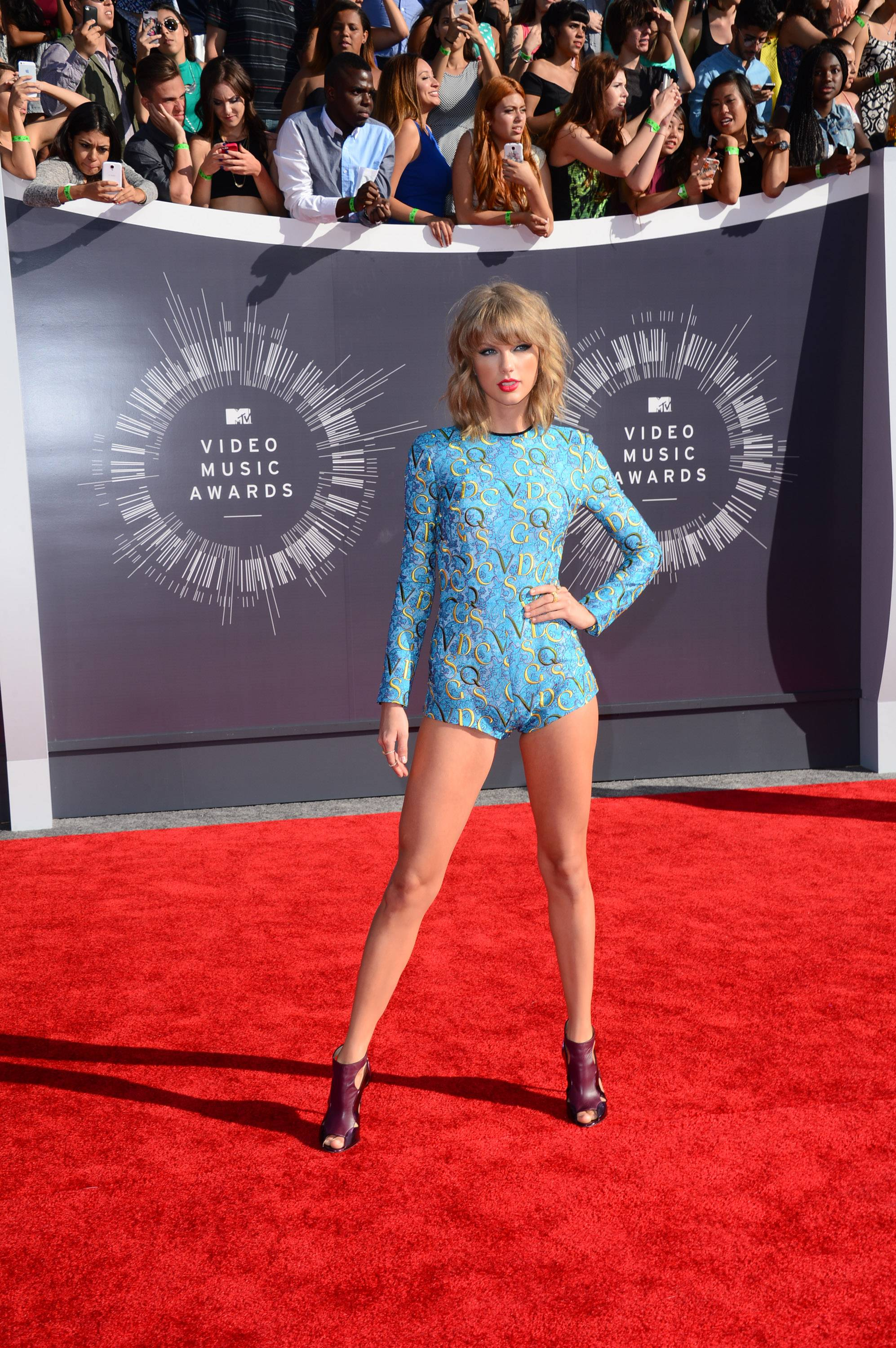 Taylor Swift and her romper walk the VMAs red carpet.