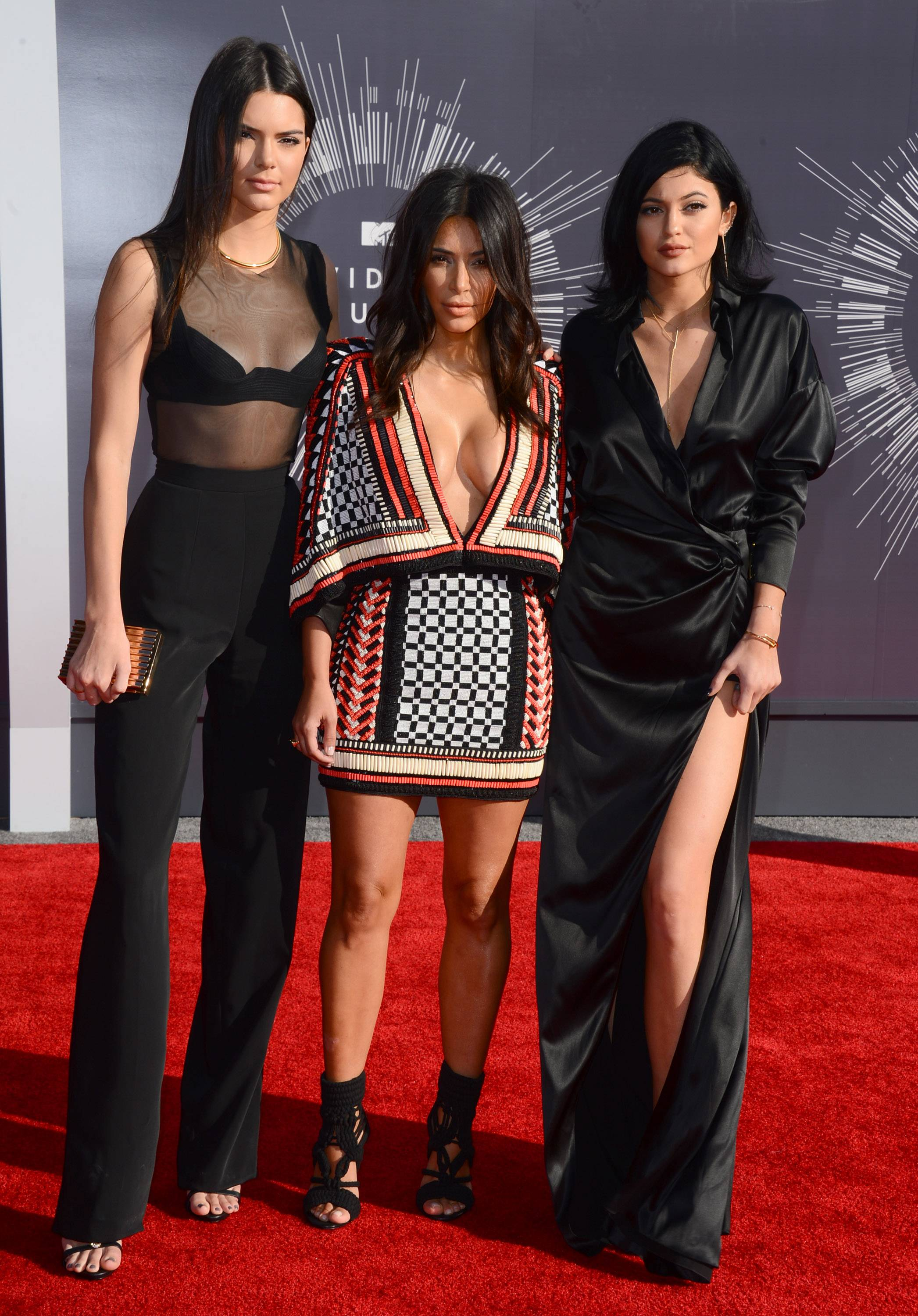 Kendall Jenner, from left, Kim Kardashian and Kylie Jenner arrive at the MTV Video Music Awards.