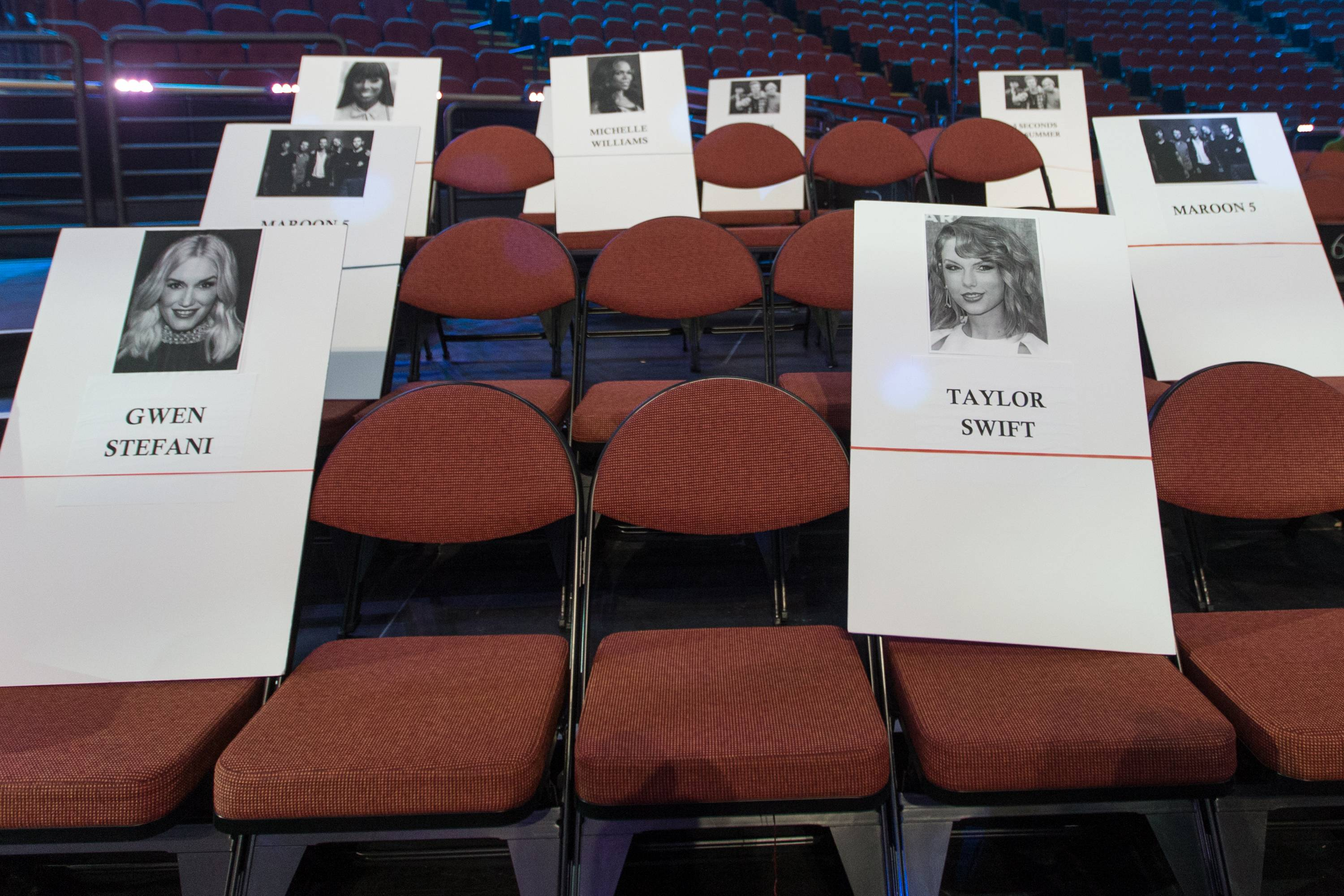 Place holders for musicians Gwen Stefani, front row left, and Taylor Swift, front row right, are displayed during the 2014 MTV Video Music Awards Press Preview Day at the Forum on Thursday in Inglewood, Calif.