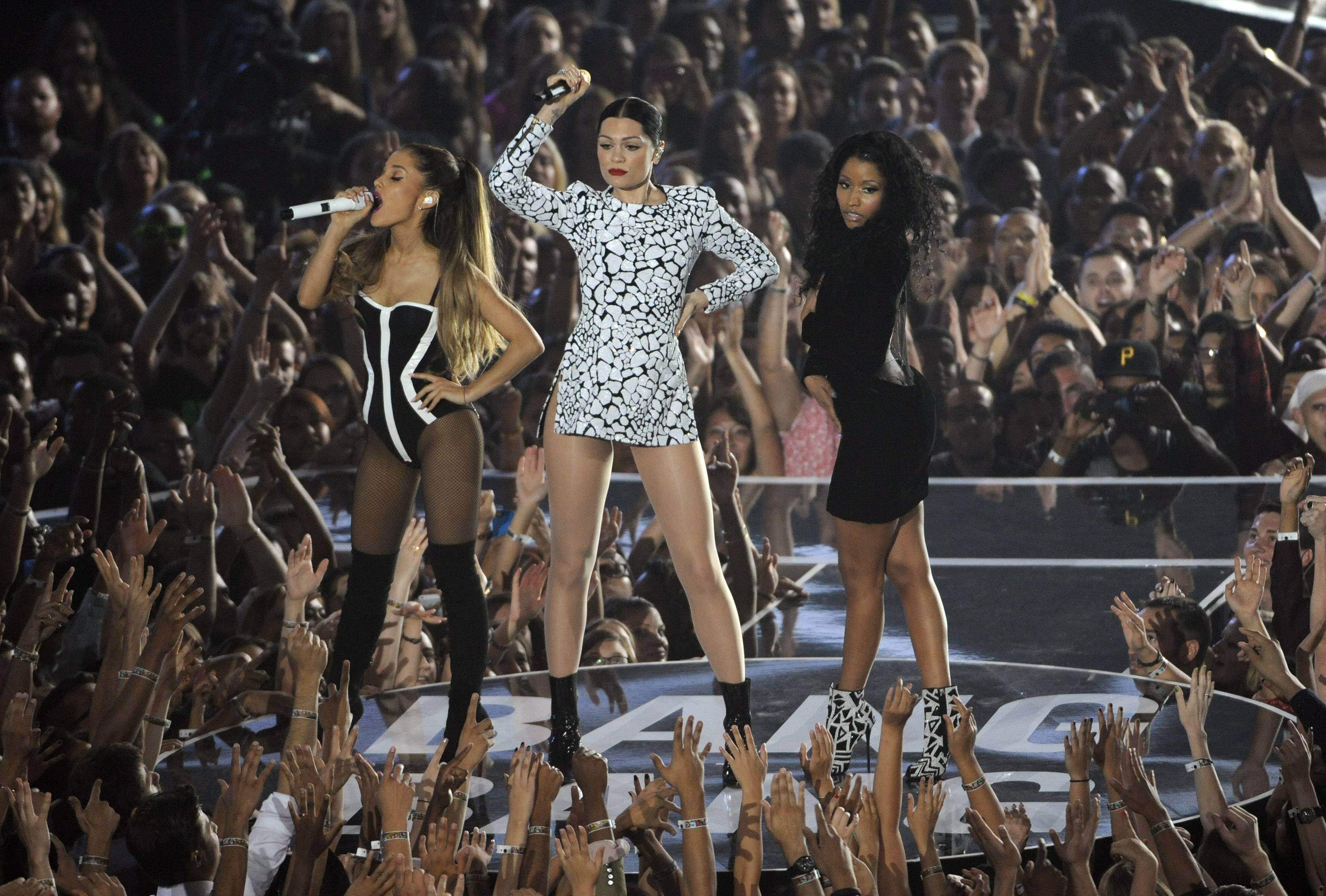 Ariana Grande, from left, Jessie J and Nicki Minaj perform at the MTV Video Music Awards.