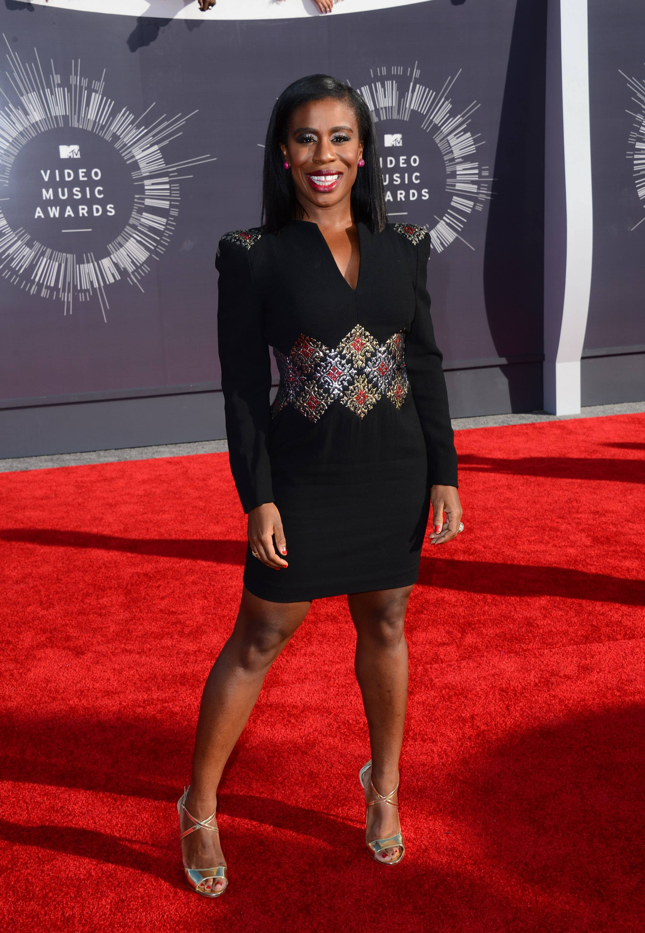 """Orange Is the New Black"" star Uzo Aduba arrives at the MTV Video Music Awards. Aduba would present with her castmates Taylor Schilling and Laverne Cox."