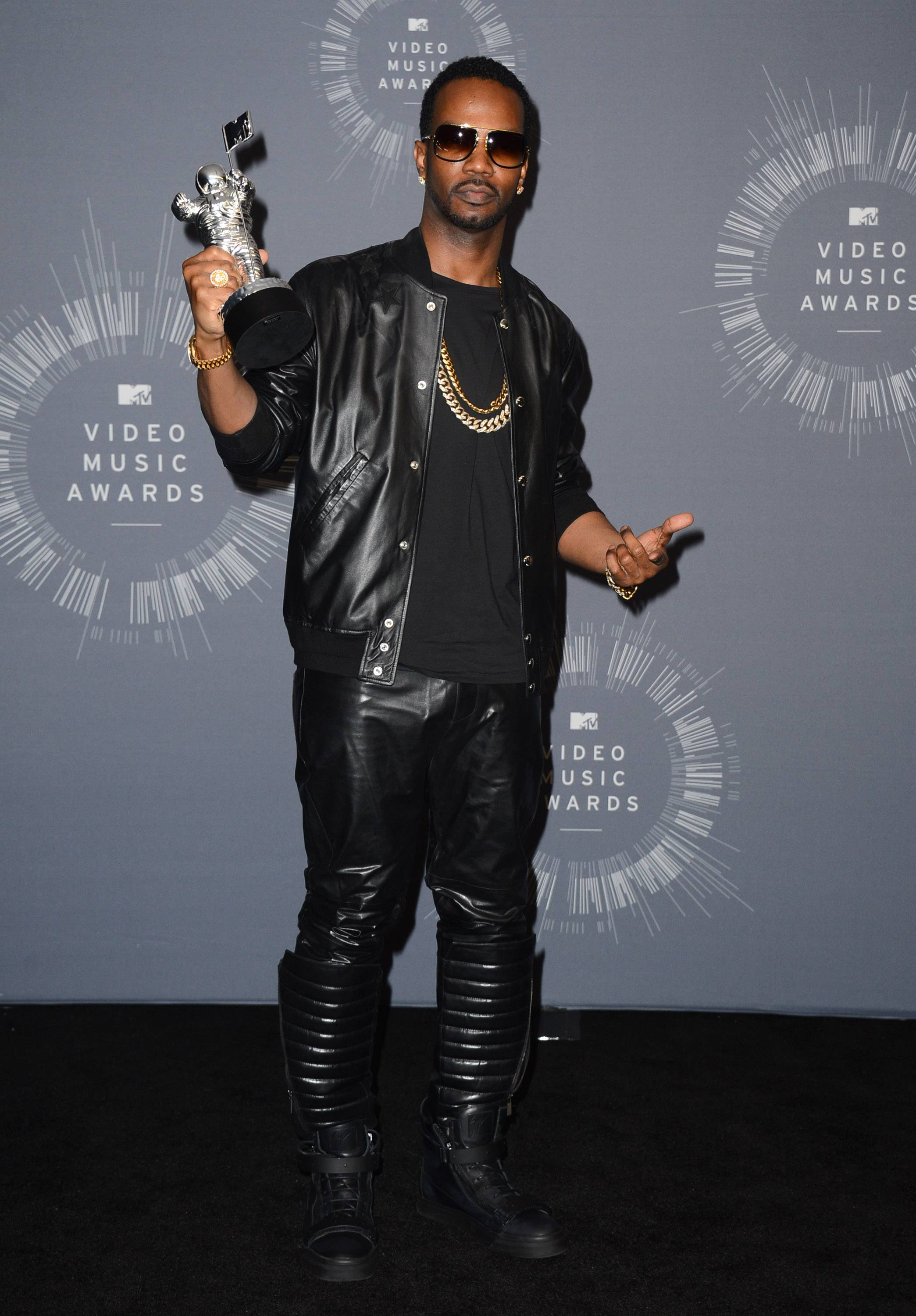 "Juicy J, featured in Katy Perry's song ""Dark Horse,"" poses in the press room with the award for Best Female Video at the MTV Video Music Awards."