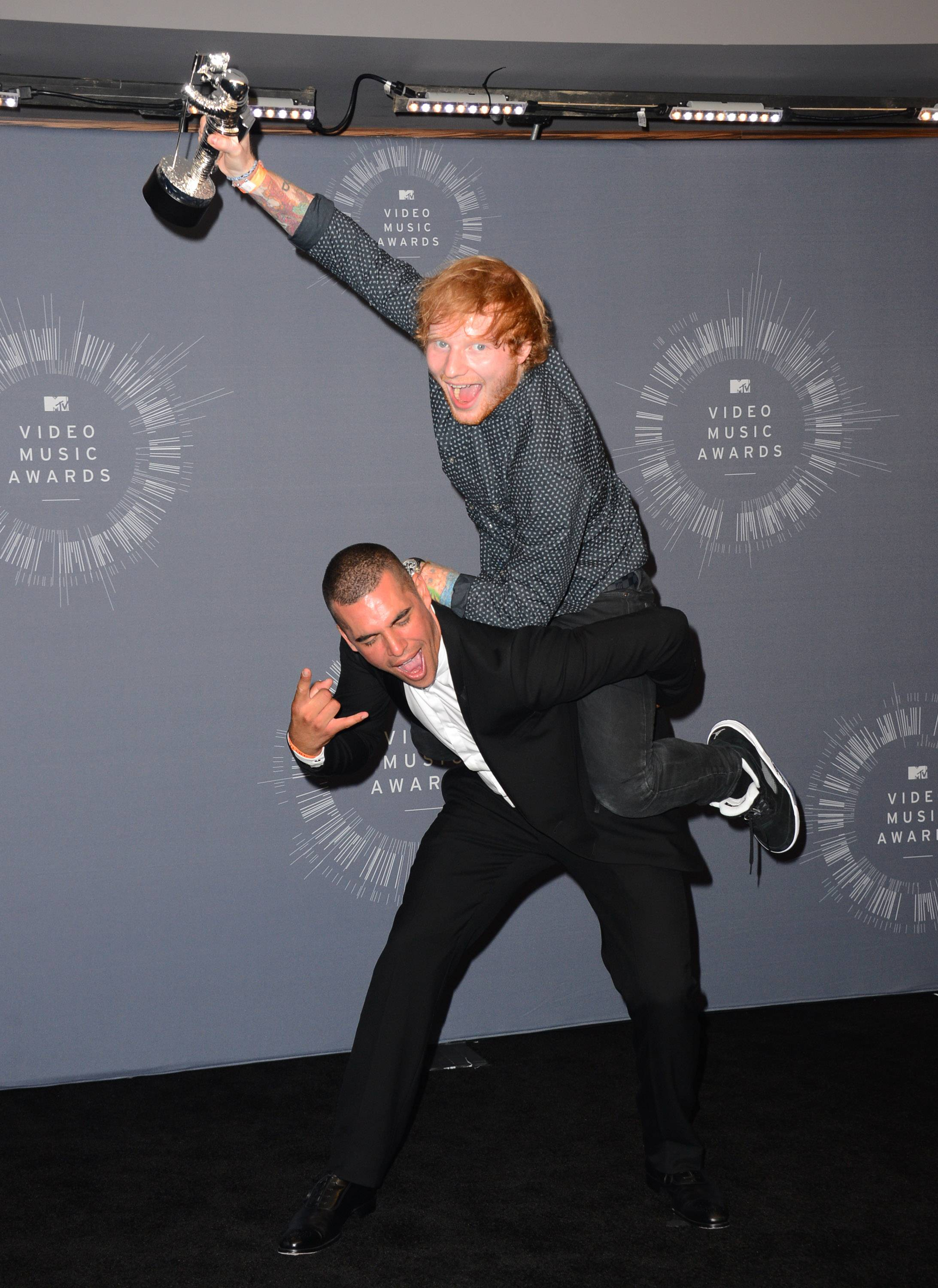 Emil Nava, left, and Ed Sheeran pose with the award for Best Male Video Award in the press room at the MTV Video Music Awards