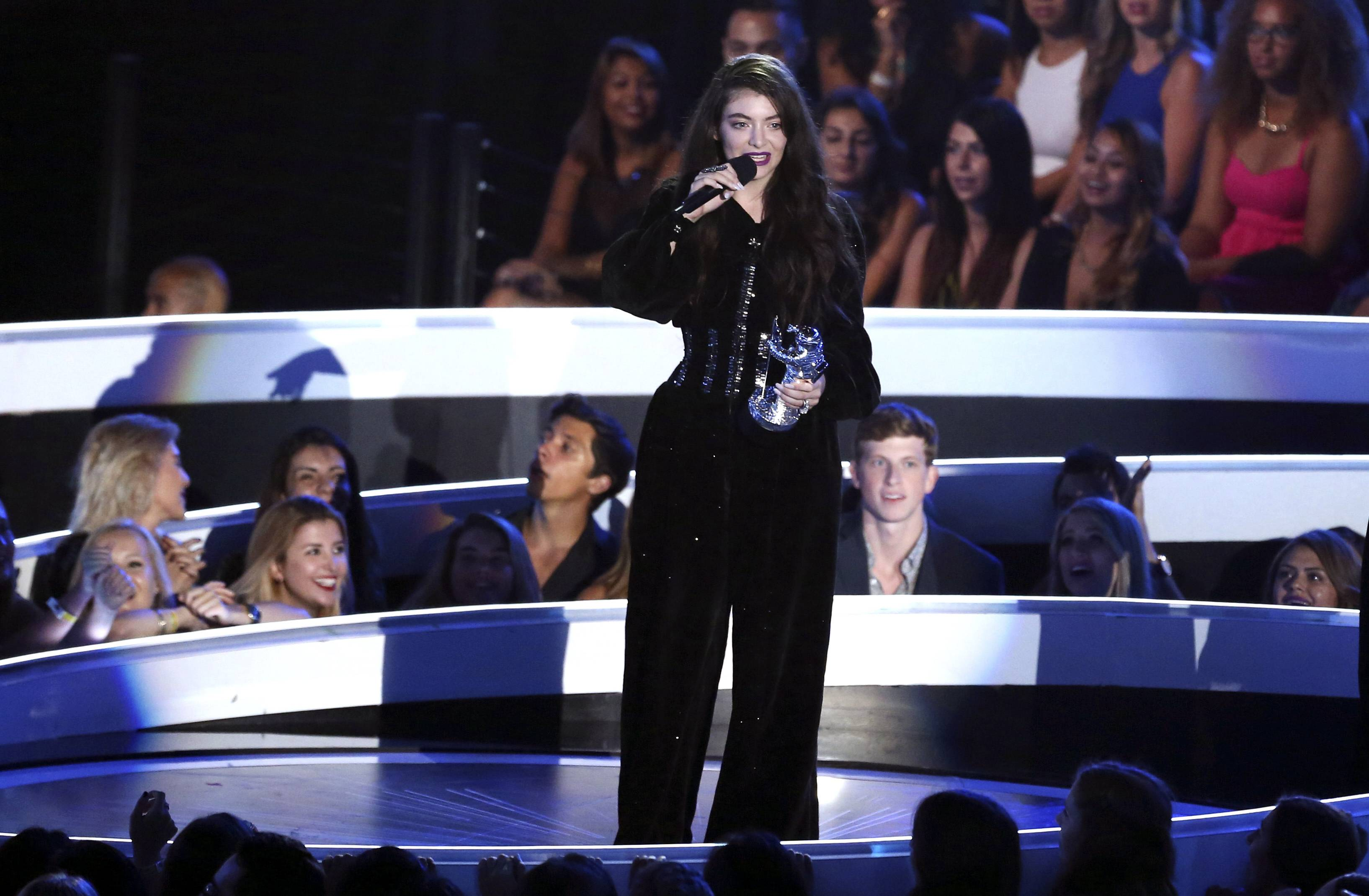 Lorde accepts the award for Best Rock Video at the MTV Video Music Awards.