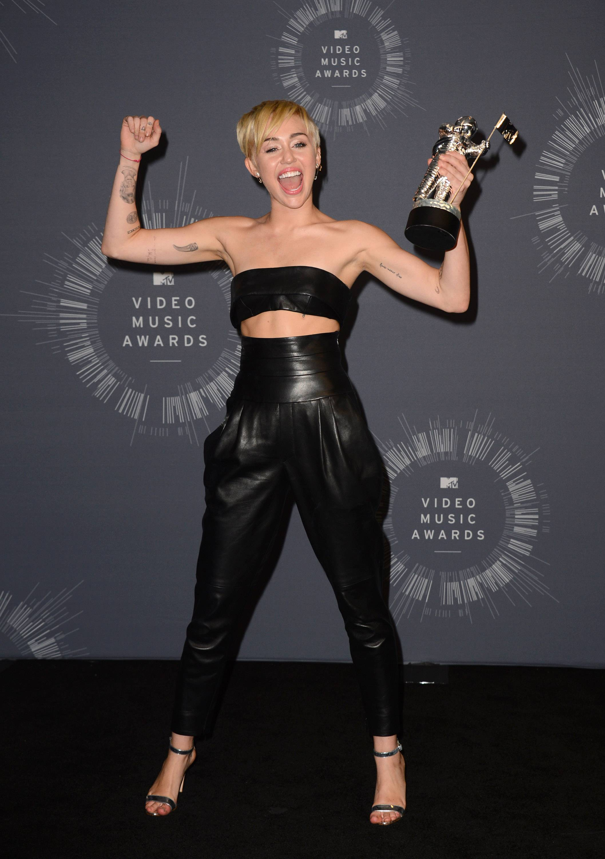 Miley Cyrus poses with the award for Video of the Year in the press room at the MTV Video Music Awards.