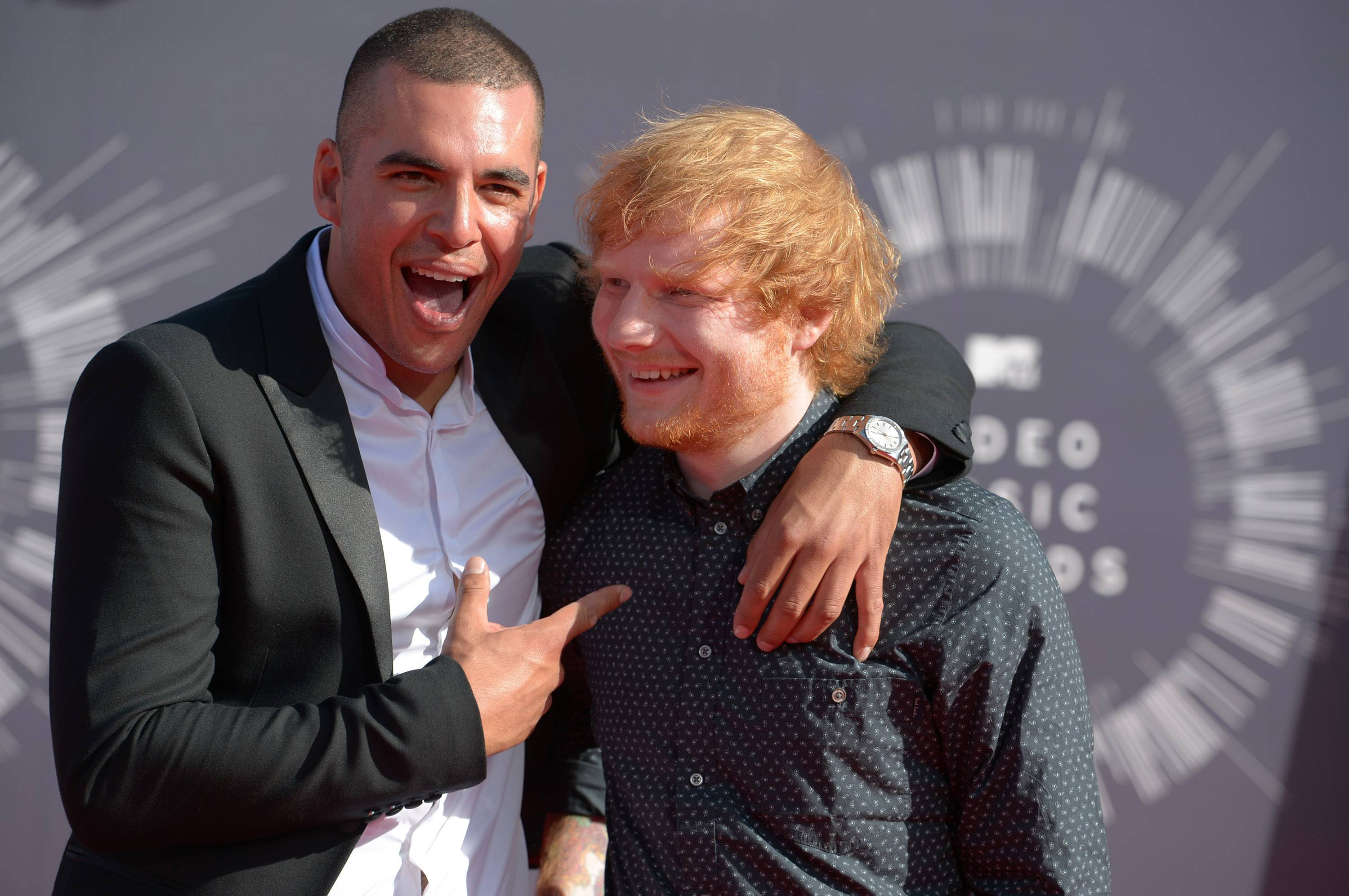 Emil Nava, left, and Ed Sheeran arrive at the MTV Video Music Awards.