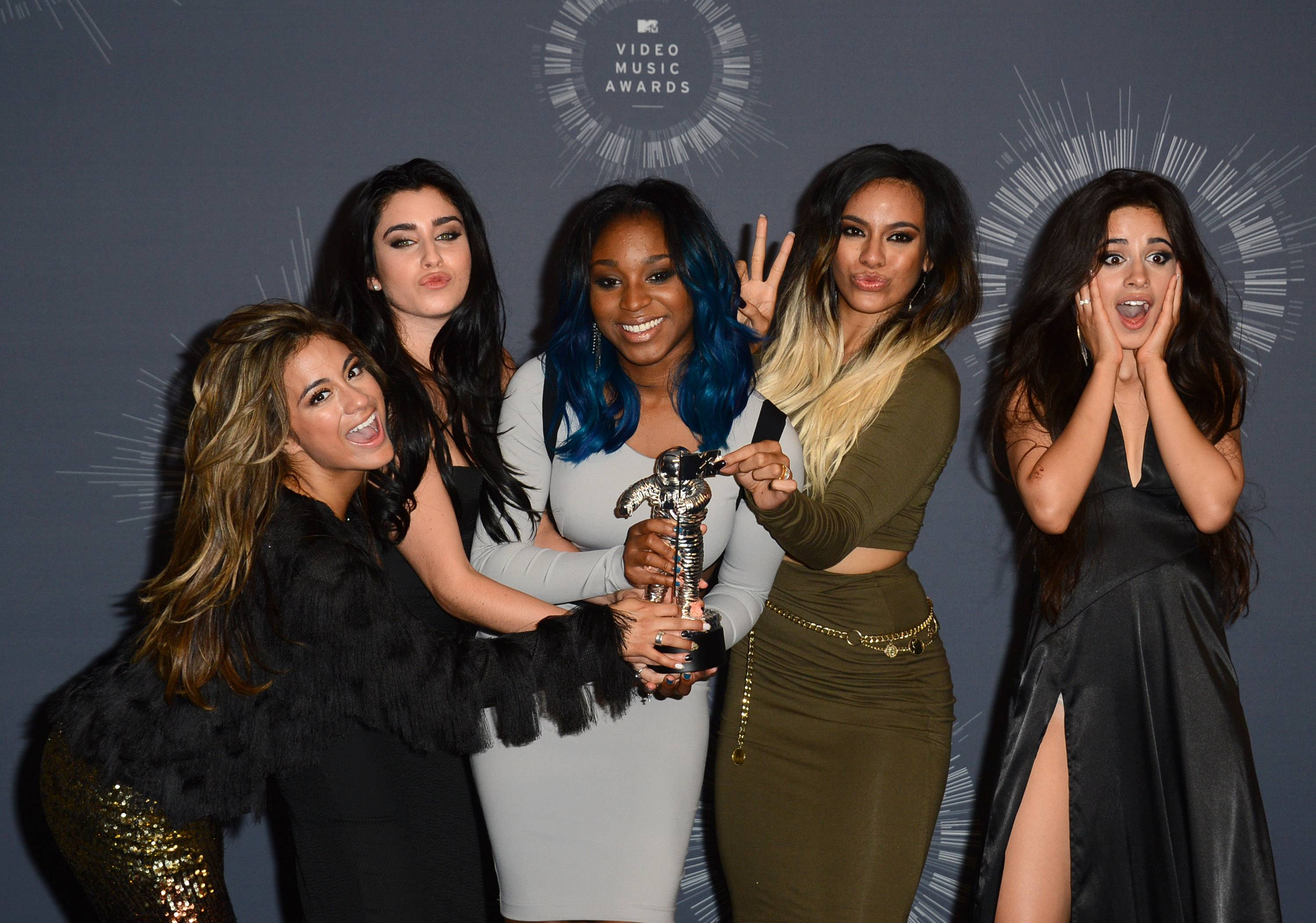 Fifth Harmony poses with the award for Artist to Watch in the press room at the MTV Video Music Awards.