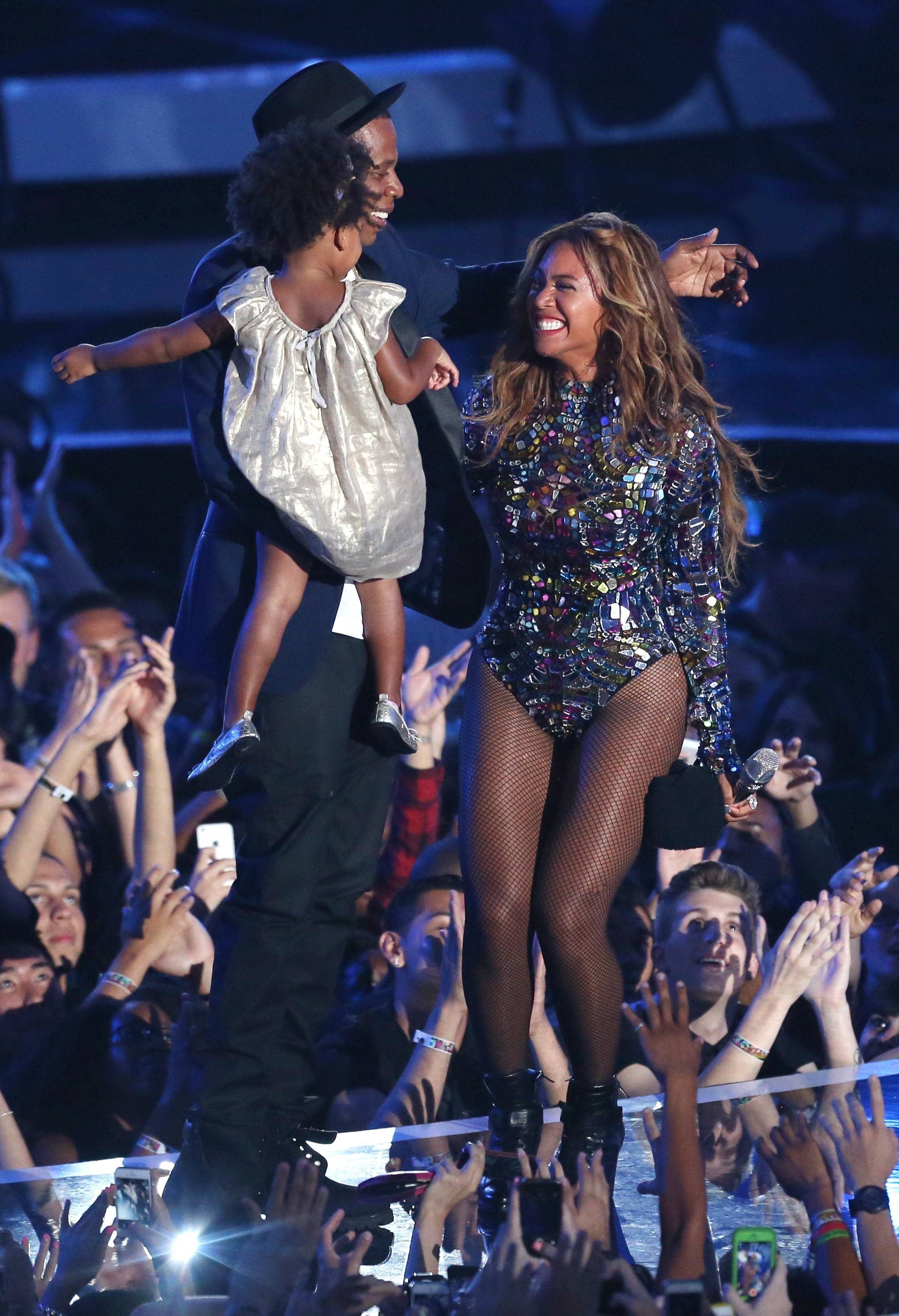 Beyonce accepts the Video Vanguard Award at the MTV Video Music Awards. Looking on from left is Blue Ivy and Jay-Z.