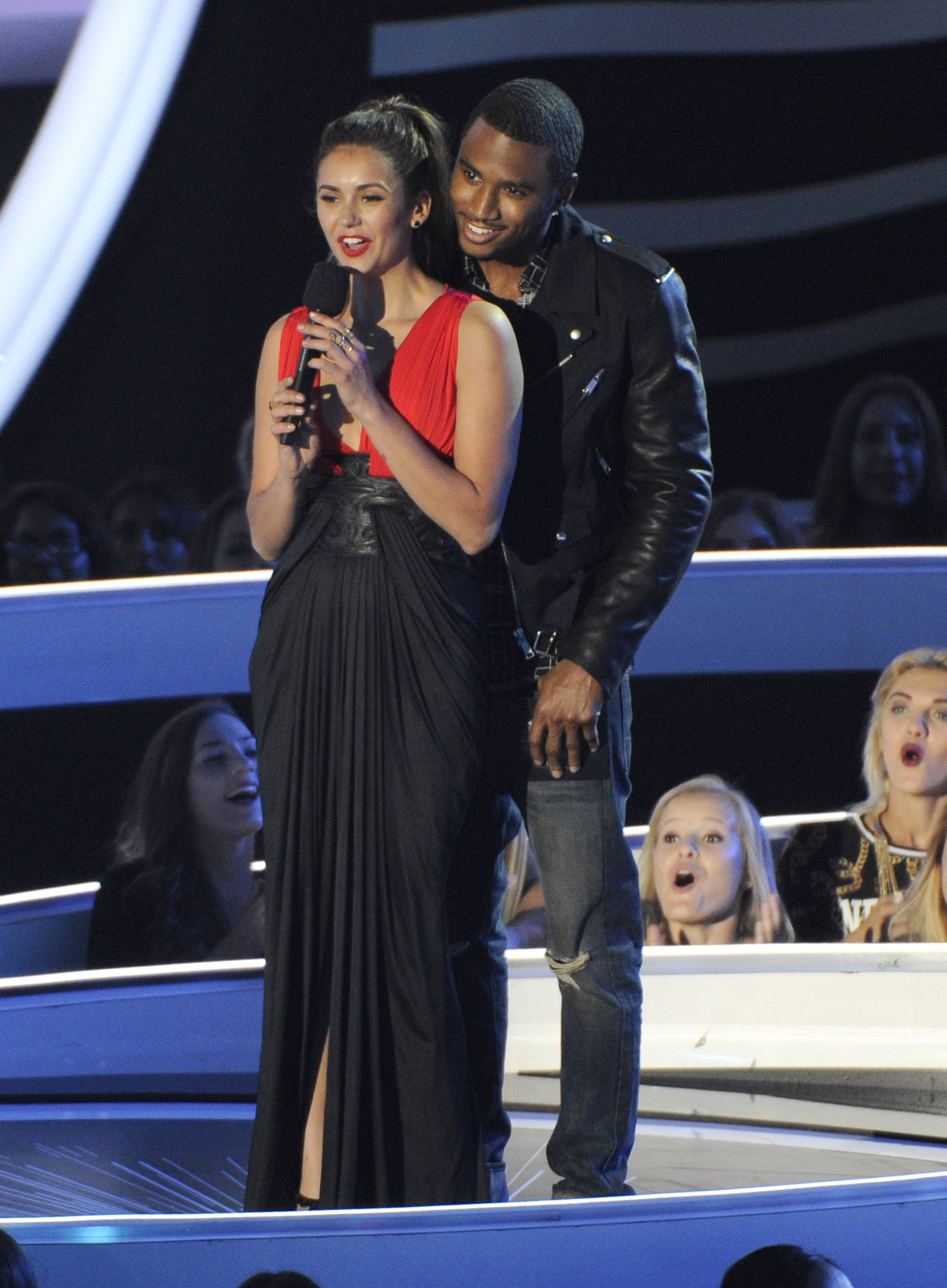 Nina Dobrev, left, and Trey Songz present the award for Best Rock Video at the MTV Video Music Awards.