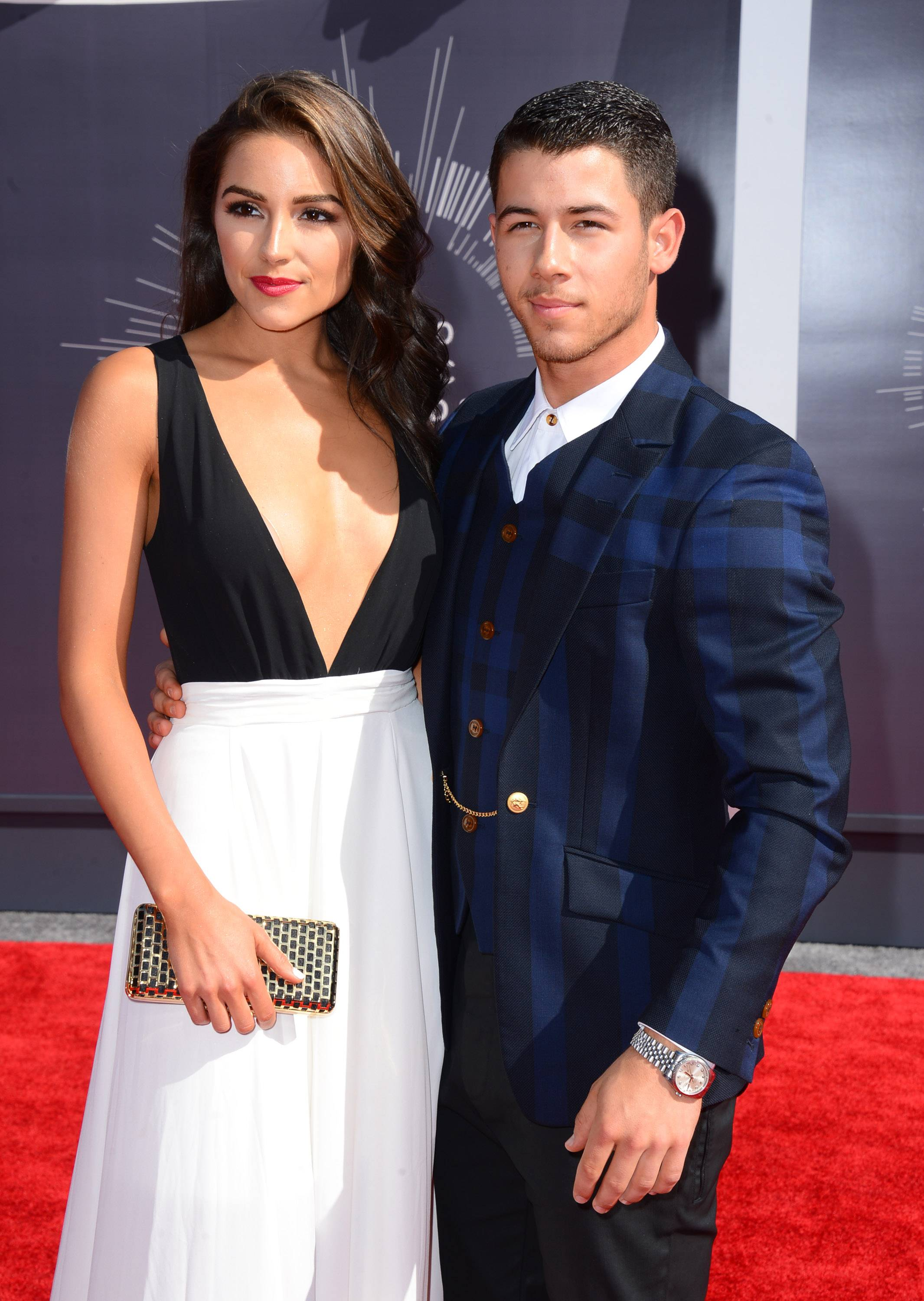 Olivia Culpo, left, and Nick Jonas arrive at the MTV Video Music Awards at The Forum on Sunday in Inglewood, Calif.