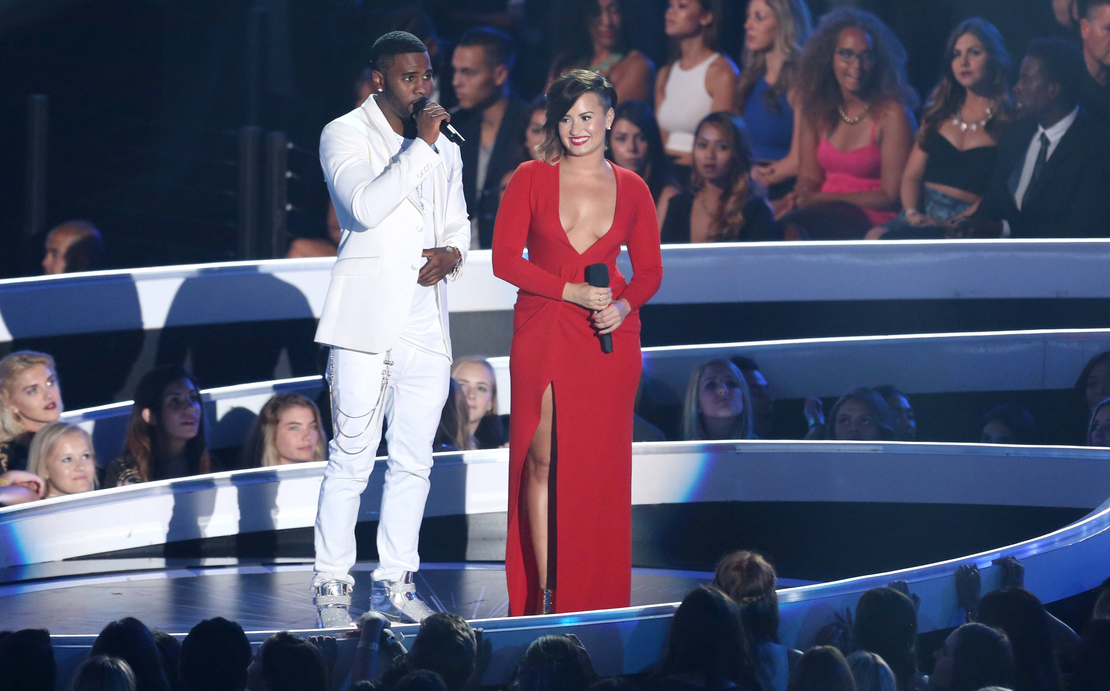 Jason Derulo, left, and Demi Lovato speak at the MTV Video Music Awards.