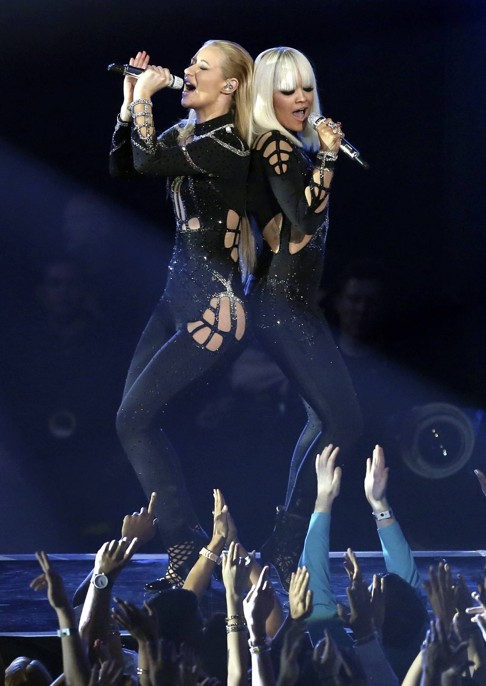 "Iggy Azalea, left, and Rita Ora perform ""Black Widow"" at the MTV Video Music Awards."