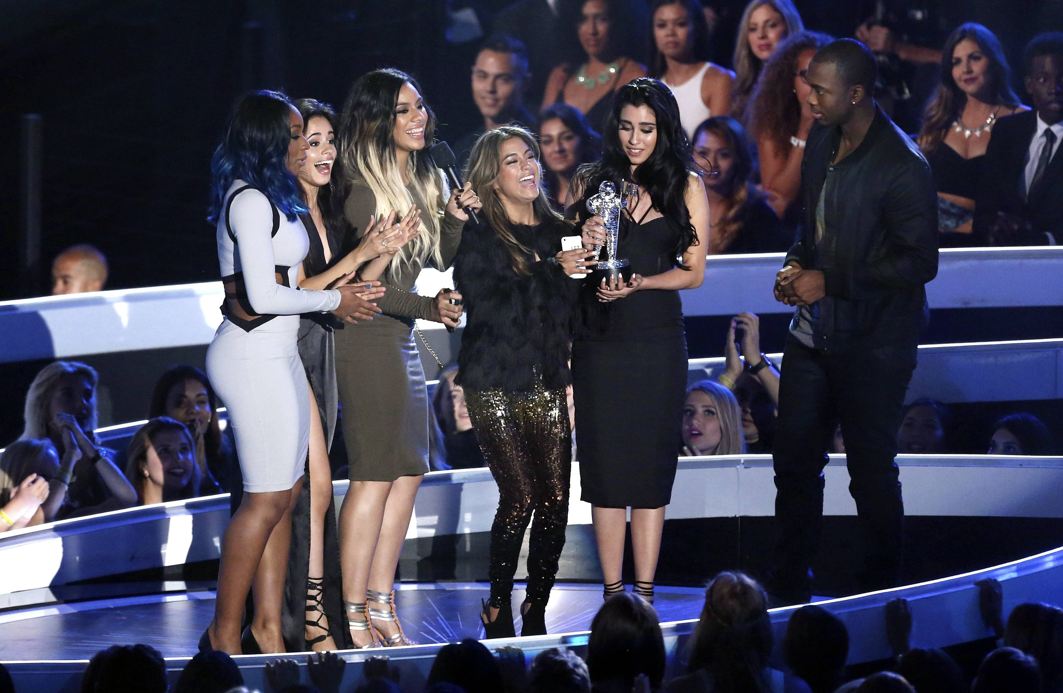 Normani Hamilton, from left, Camila Cabello, Dinah Jane Hansen, Ally Brooke and Lauren Jauregui of Fifth Harmony accept the award for Artist to Watch at the MTV Video Music Awards.