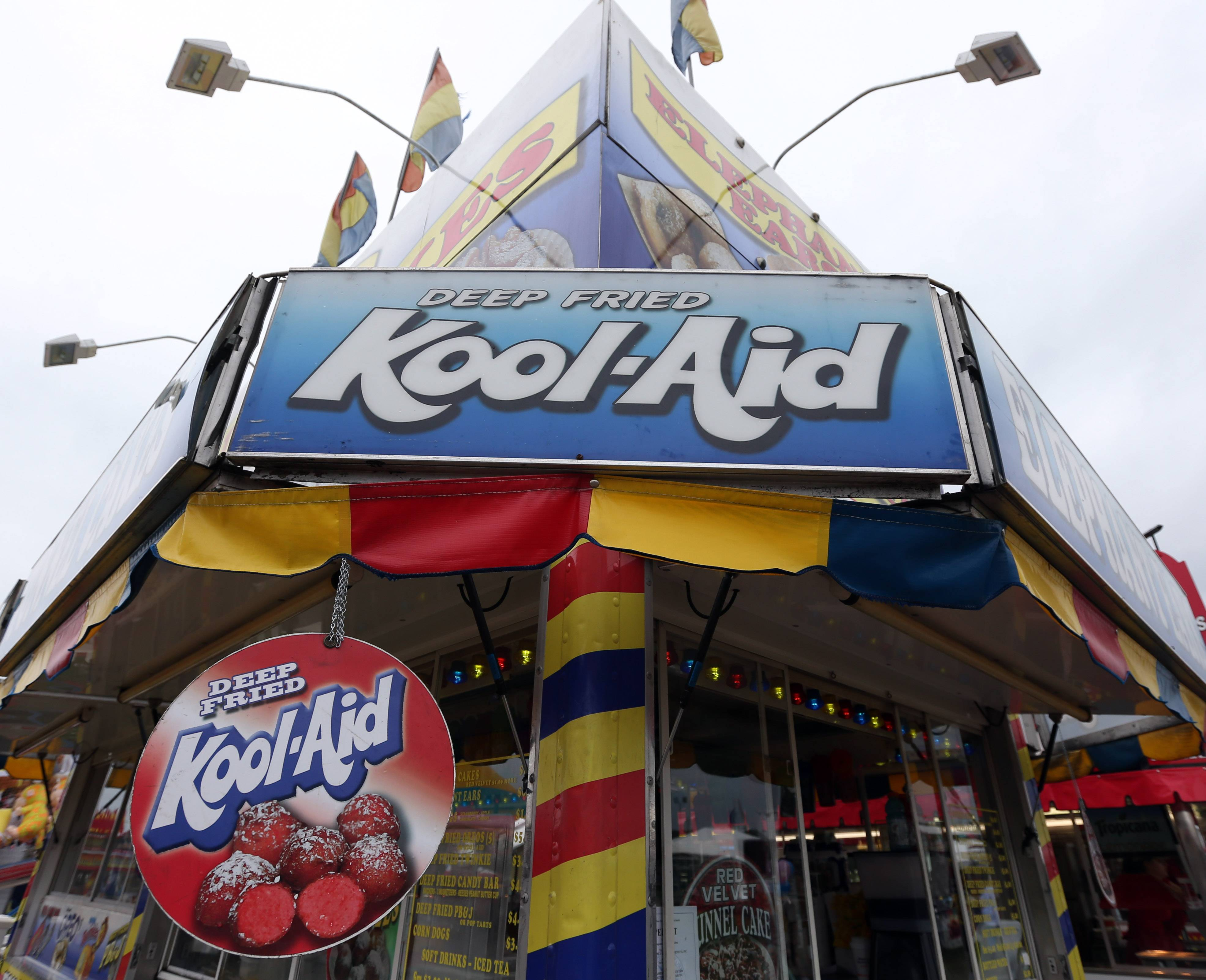 A sign advertises deep-fried Kool-Aid at a food vendor at the Washington County Fair last week in Greenwich, N.Y. The creators of fair concoctions say they work all year to outdo themselves and the other vendors vying for the attention of an ever more expectant public.