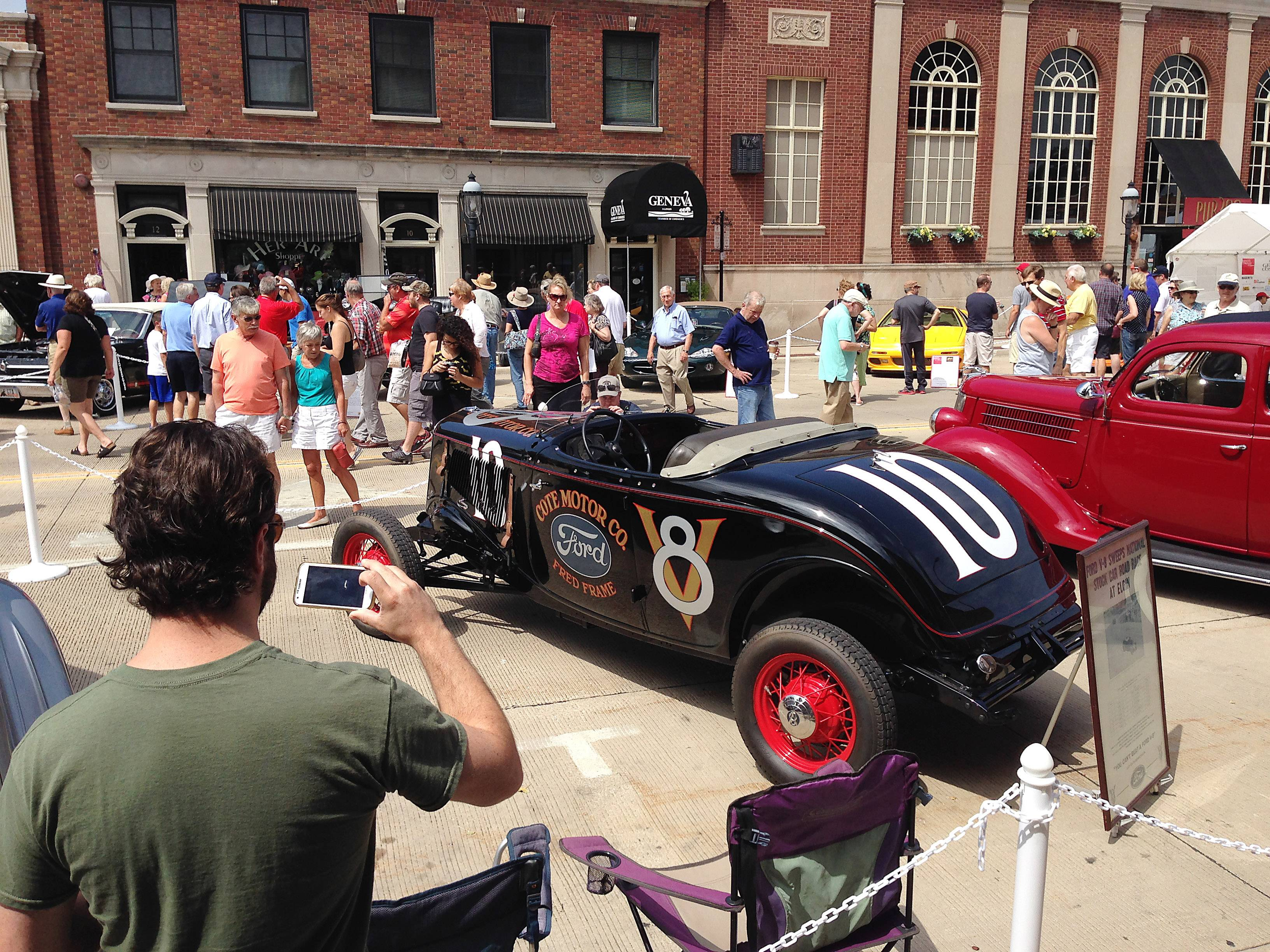 Auto enthusiasts stop Sunday in Geneva to take photos of the car that won the 1933 Elgin National Road Race. The car was one of more than 200 classic, exotic and rare automobiles on display during the Geneva Concours d'Elegance.