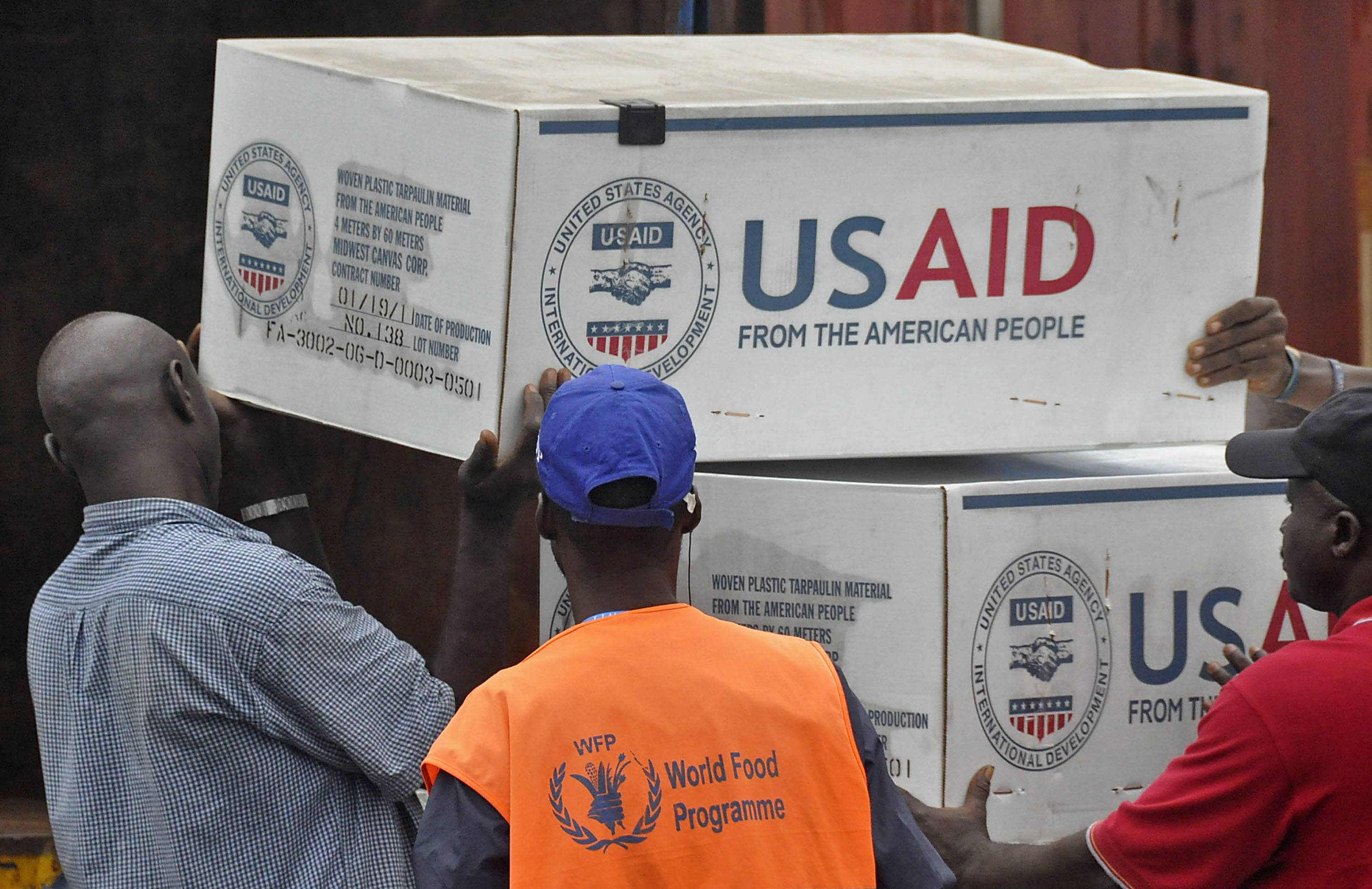 American Aid goods are loaded onto a truck after it arrived by airplane, to be used in the fight against the Ebola virus spreading in the city of Monrovia, Liberia, Sunday. Two alarming new cases of Ebola have emerged in Nigeria, widening the circle of people sickened beyond the immediate group of caregivers who treated a dying airline passenger in one of Africa's largest cities.