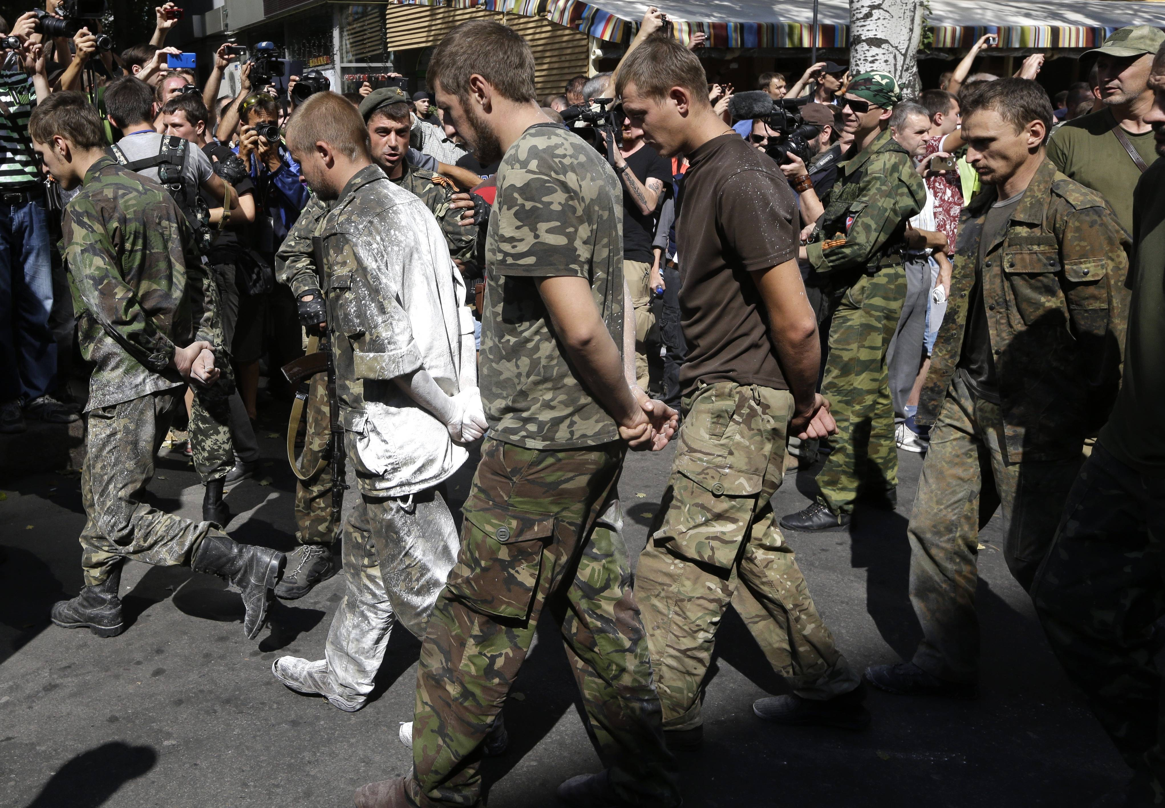Pro-Russian rebels escort prisoners of war from the Ukrainian army in a central square in Donetsk, eastern Ukraine, Sunday. Ukraine has retaken control of much of its eastern territory bordering Russia in the last few weeks, but fierce fighting for the rebel-held cities of Donetsk and Luhansk persists.