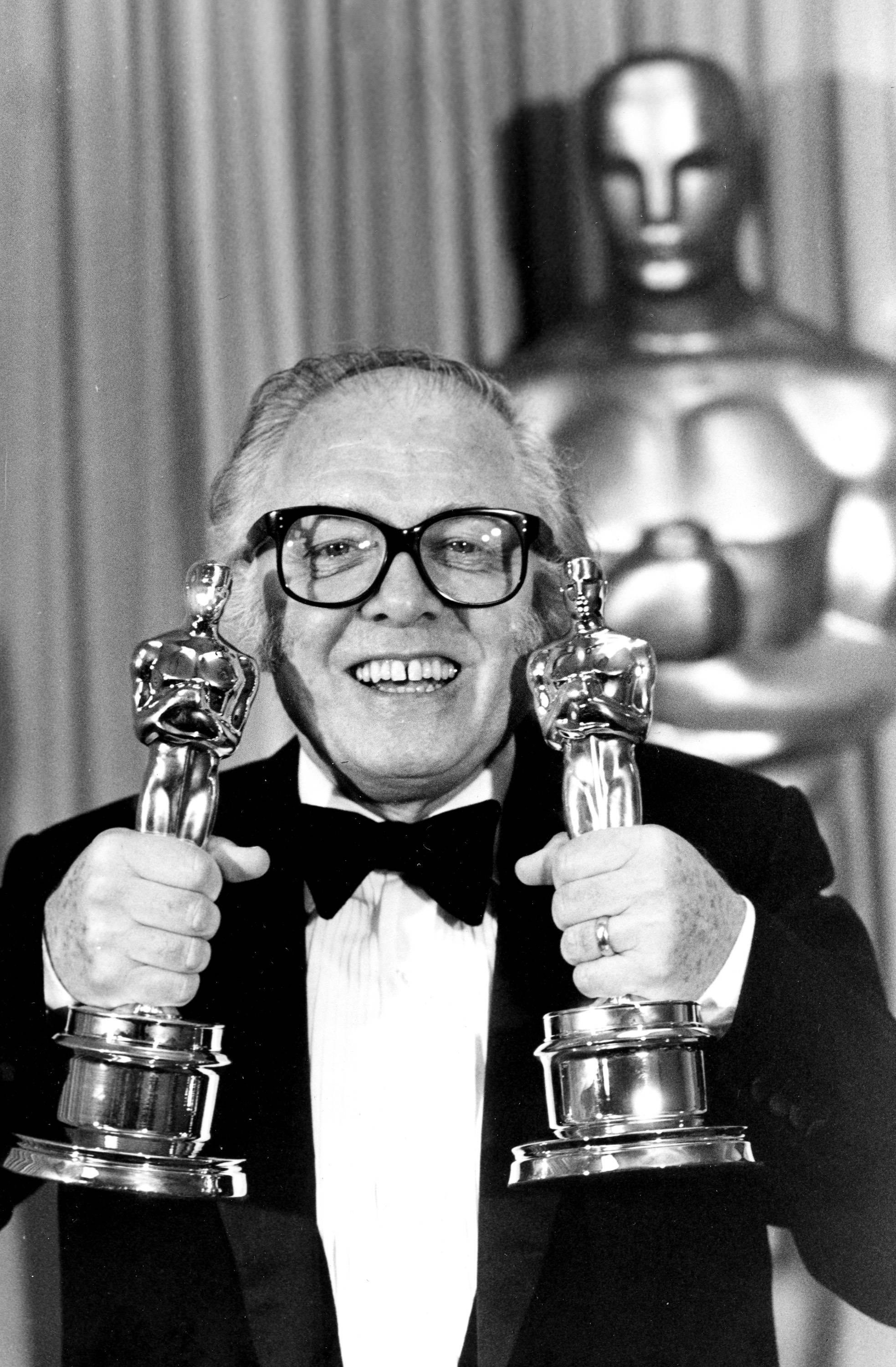 "British actor and director Richard Attenborough holds his two Oscars for his epic movie ""Gandhi"" at the 55th annual Academy Awards in Los Angeles in this April 11, 1983, file photo. The acclaimed actor and Oscar-winning director, whose film career on both sides of the camera spanned 60 years, died on Sunday. He was 90."