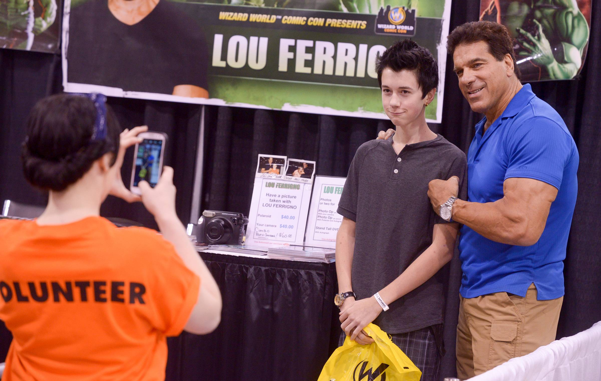 "Noah Fuller, 15 of Tinley Park poses for a photo with Lou Ferrigno, aka the ""Hulk"" from the 1970s TV during his visit to the Comic Con convention at the Donald E. Stephens Convention Center in Rosemont. Fuller said his dad used to watch the Hulk on TV when he was a kid."