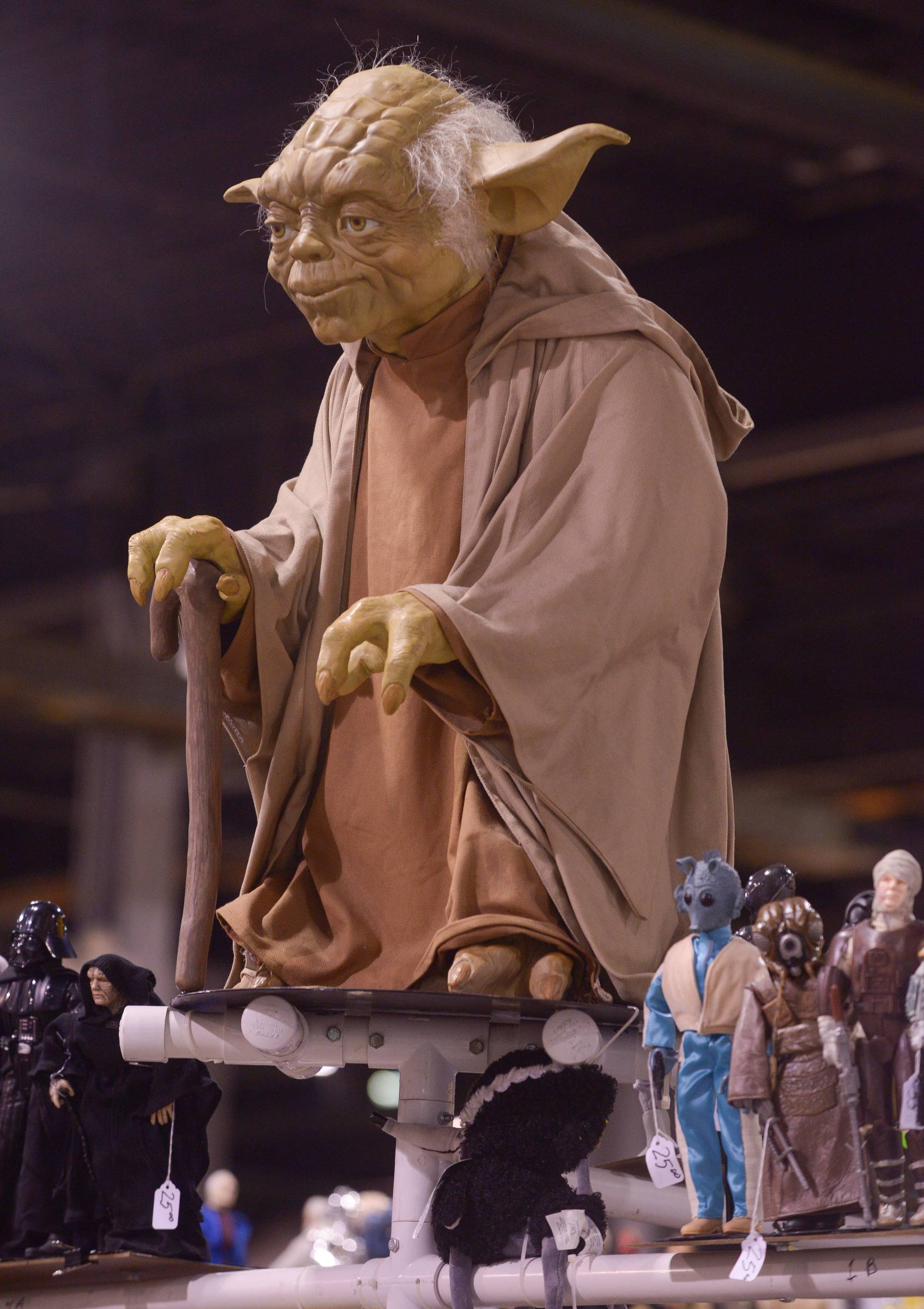 Mark Black/mblack@dailyherald.comFigures large and small of iconic characters such as Yoda from Star Wars were available for sale one many vendor booths at the Comic Con convention at the Donald E. Stephens Convention Center in Rosemont Saturday.