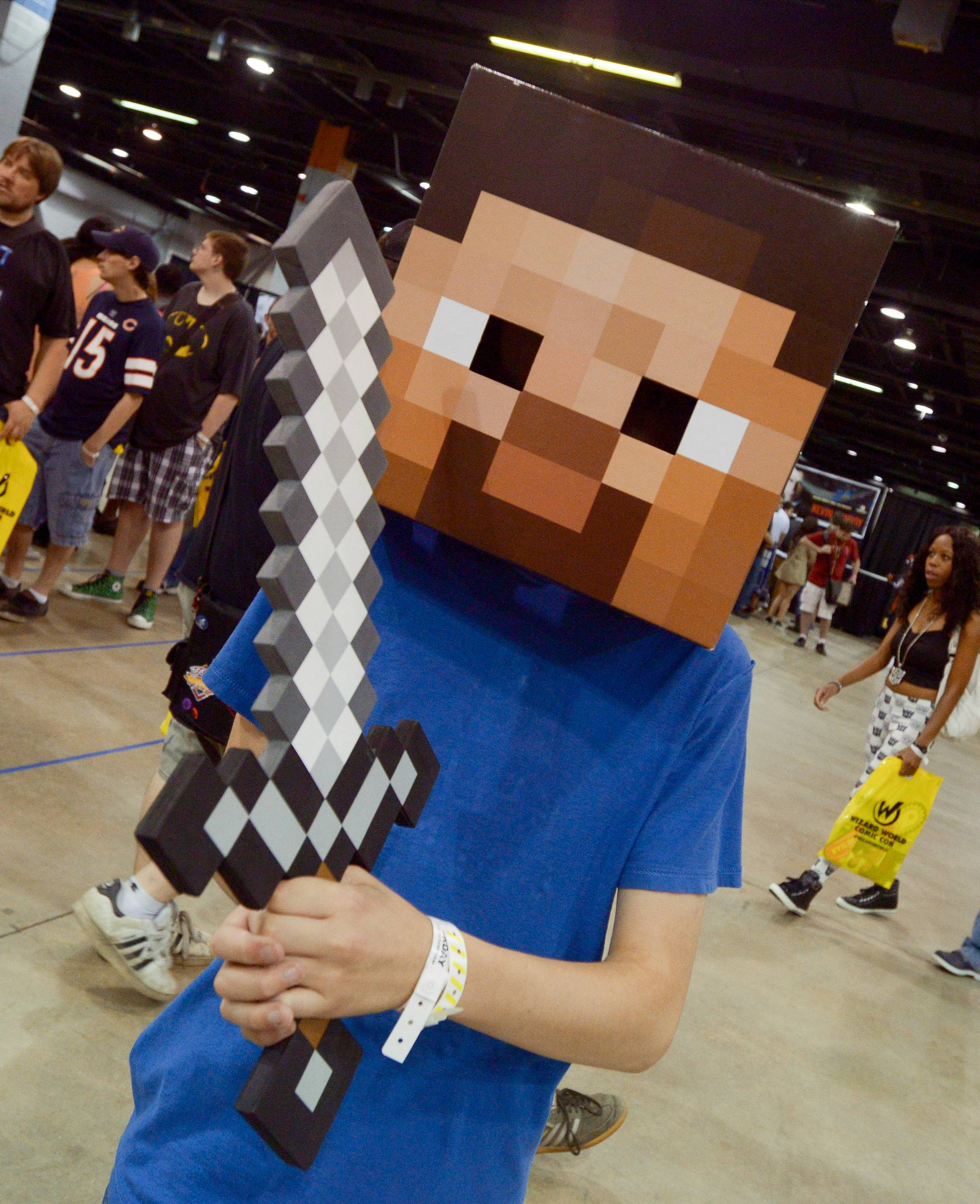 Mark Black/mblack@dailyherald.comThe Donald E. Stephens Convention Center in Rosemont was filled with many fans of Comic Con who came fully dressed as their favorite characters such as this guy dress as a MindCraft character.