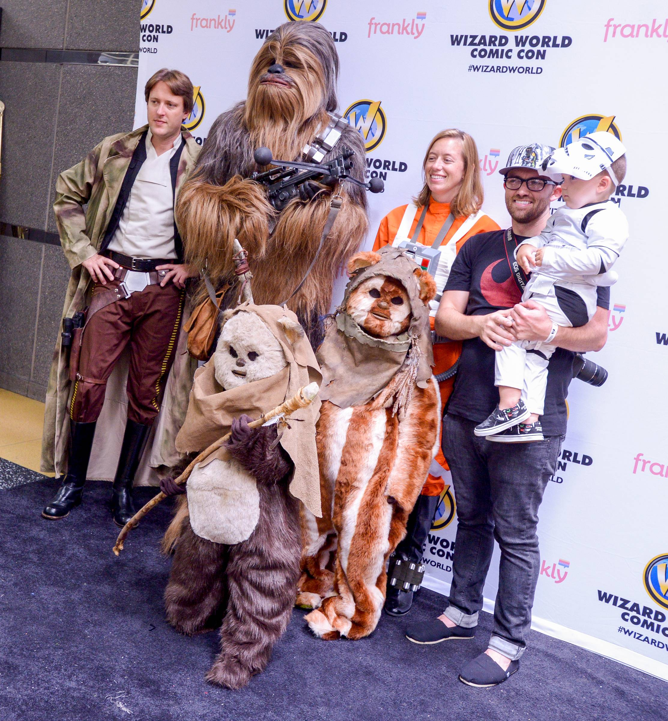 Chip Webb and his some Knox, 2 dressed as a mini Stormtrooper from Star War pose with for a photo with other Star Wars characters during the Comic Con convention at the Donald E. Stephens Convention Center in Rosemont.