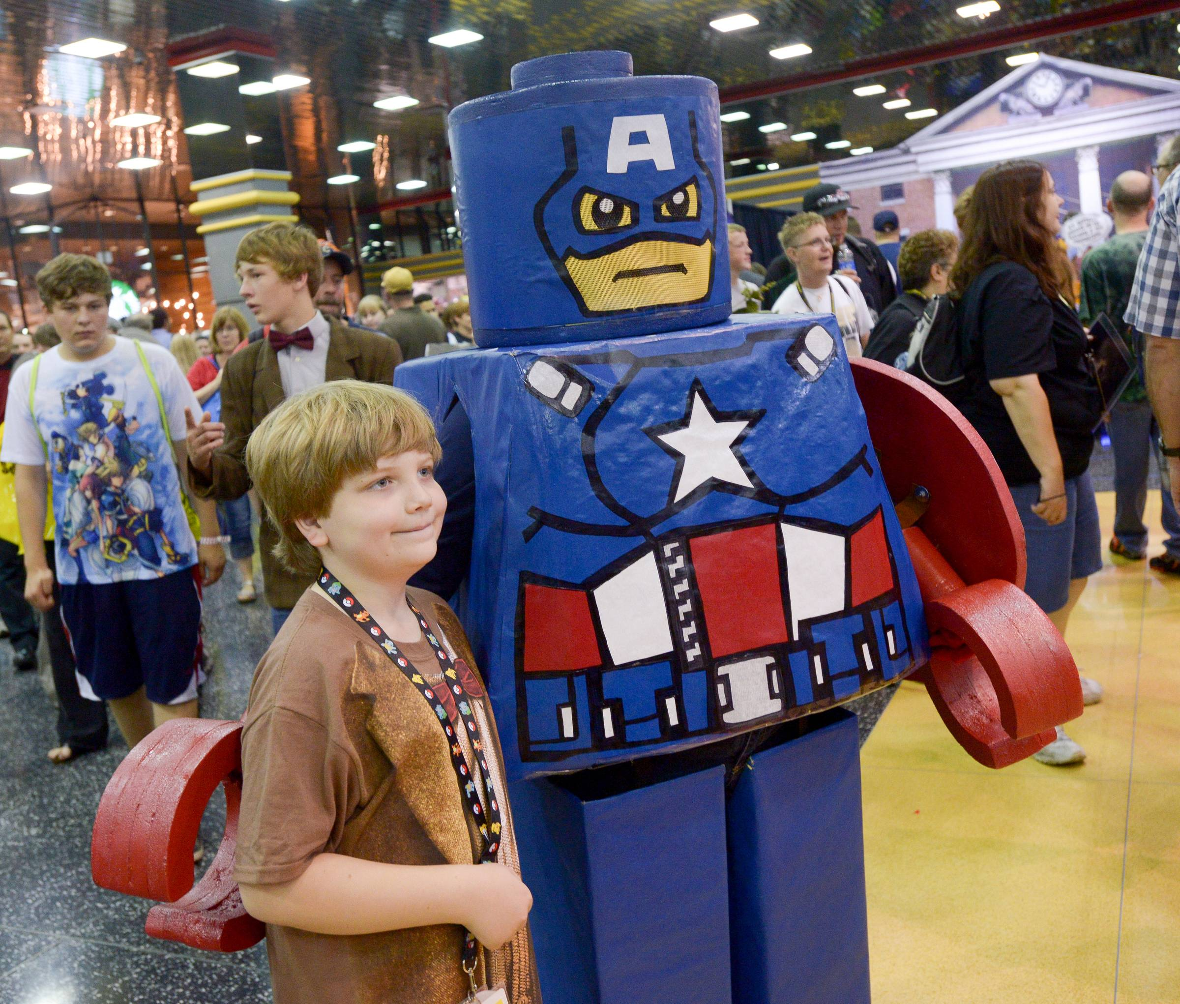Aiden Wilbanks of Huntsville Alabama pose for a photo with a Lego Captain American while visiting the Comic Con convention at the Donald E. Stephens Convention Center in Rosemont.