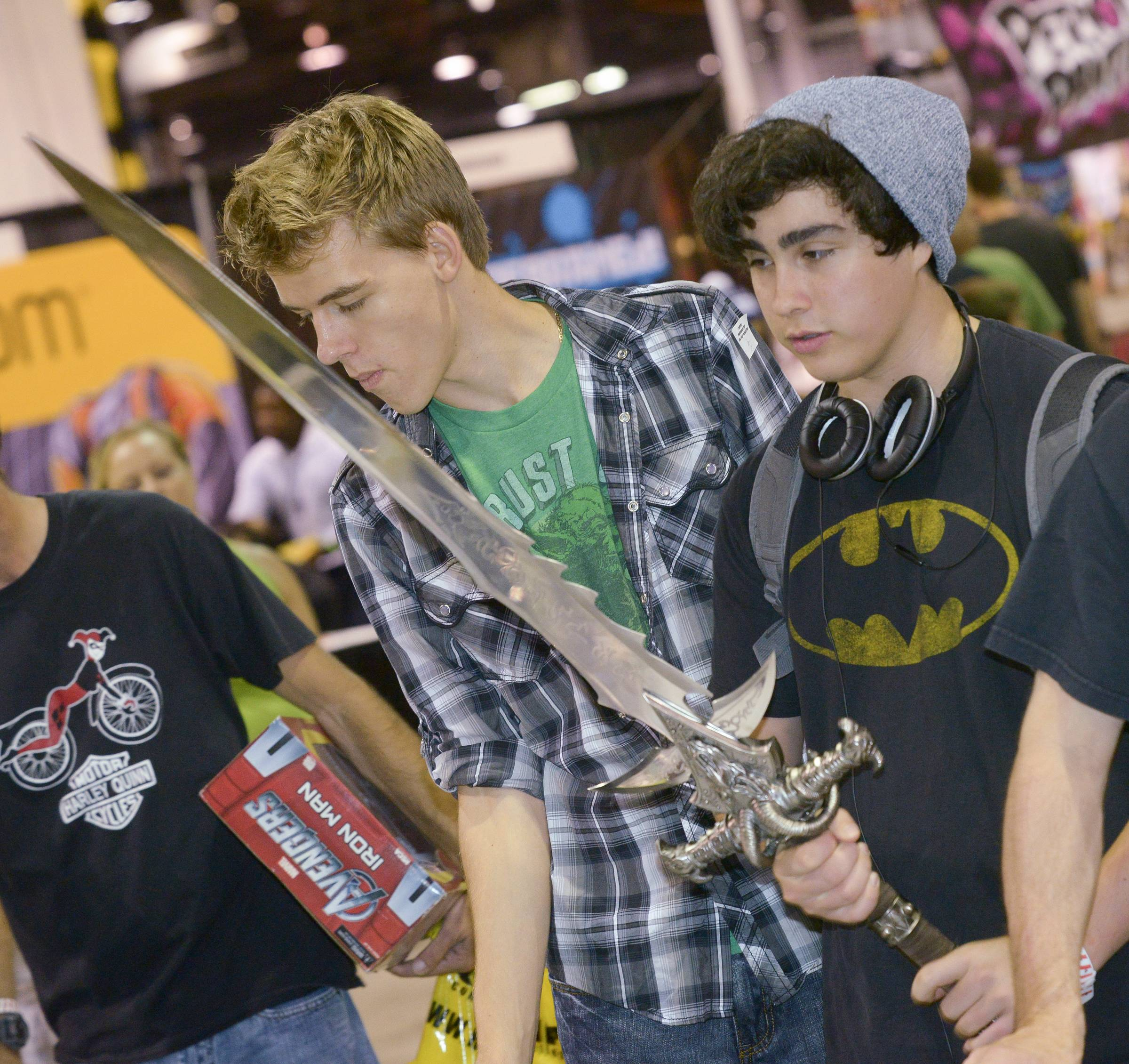 Mark Black/mblack@dailyherald.comAidean Lynch of Bloomington, Indiana, checks out a sword Saturday during the Comic Con convention at the Donald E. Stephens Convention Center in Rosemont.