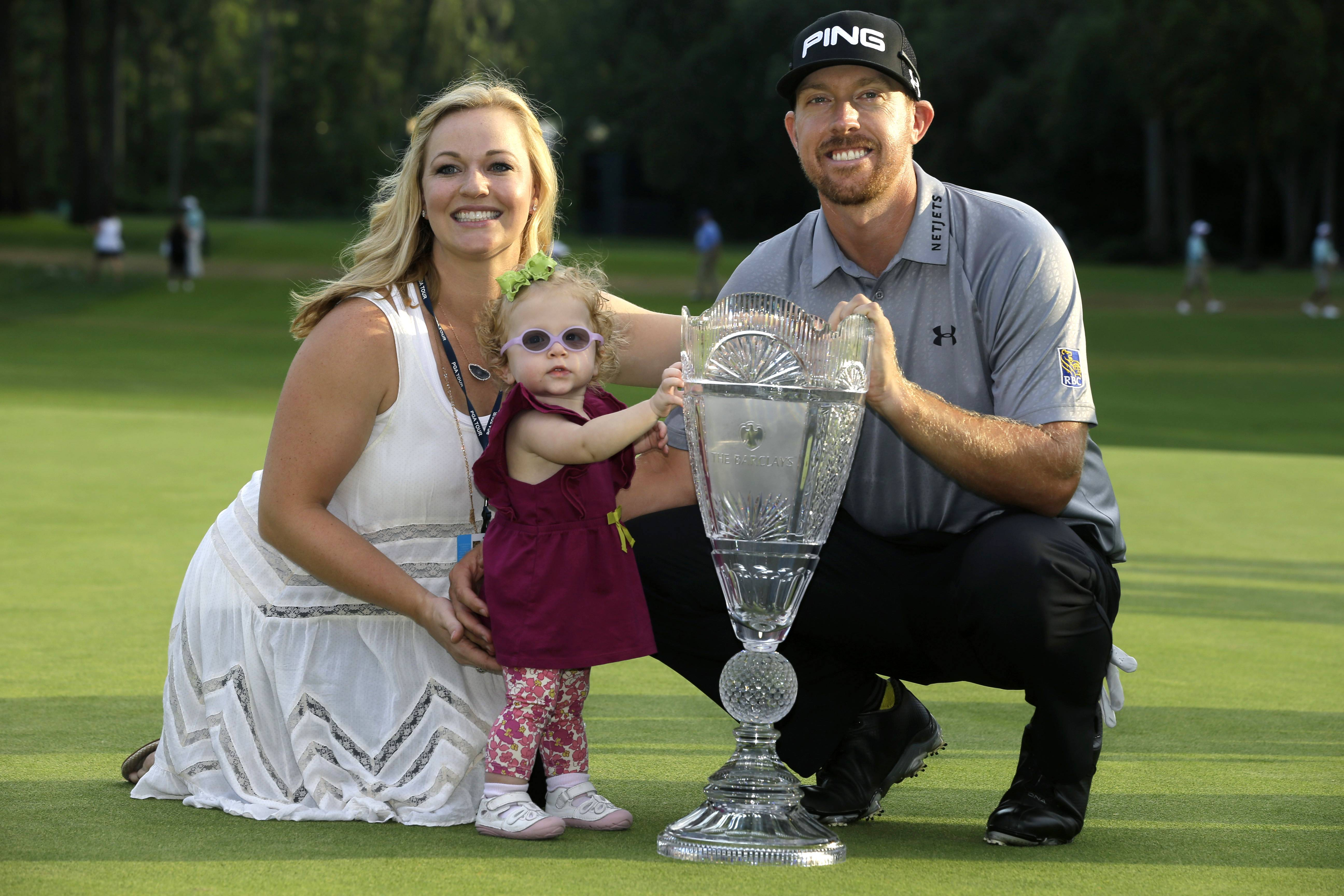Hunter Mahan poses with his wife, Kandi, and daughter Zoe and the trophy after winning the The Barclays golf tournament Sunday in Paramus, N.J.