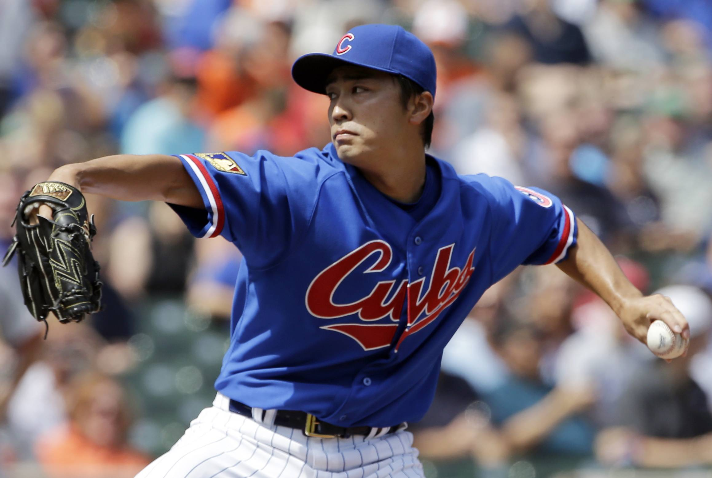 Chicago Cubs starter Tsuyoshi Wada, of Japan, throws against the Baltimore Orioles during the first inning -- the first of more than 6 without giving up a hit.