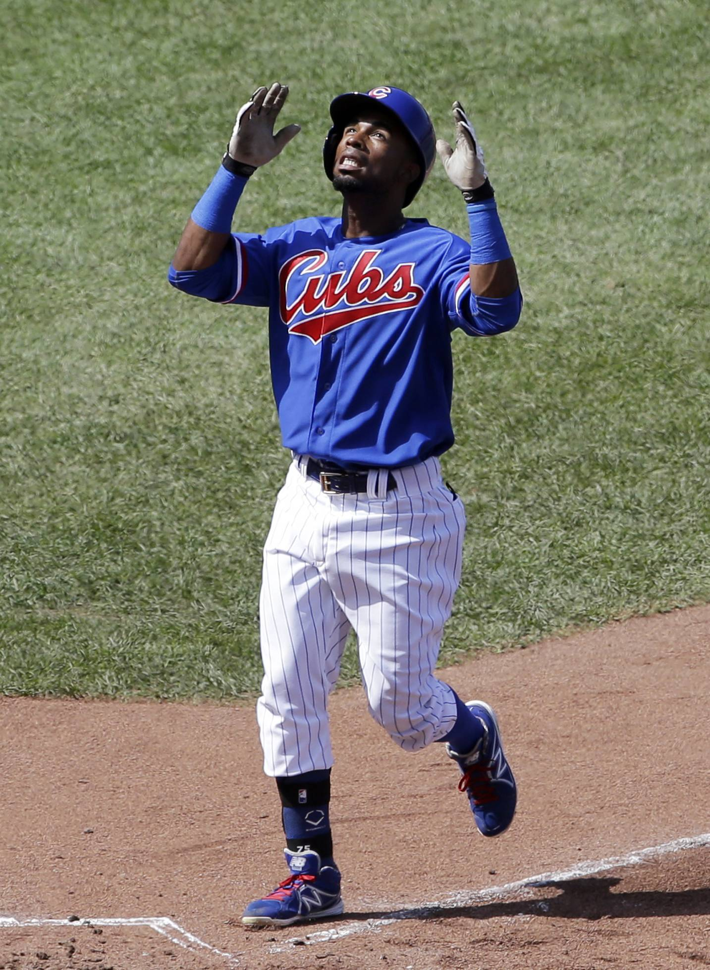 Chicago Cubs' Arismendy Alcantara celebrates after hitting a solo home run during the fifth inning against the Baltimore Orioles in Chicago, Sunday.