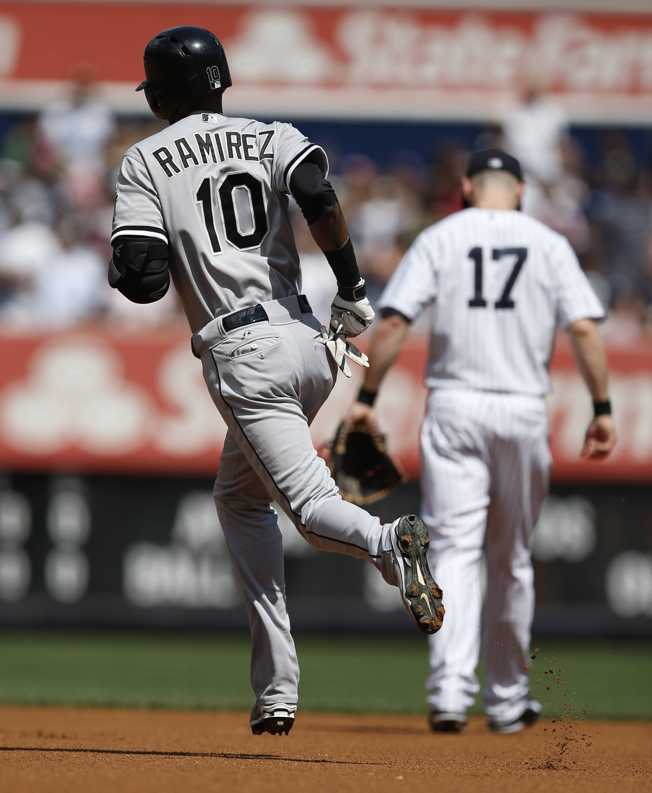 Chicago White Sox Alexei Ramirez (10) trots the bases past New York Yankees second baseman Brendan Ryan (17) after hitting a first-inning, solo home run off New York Yankees starting pitcher Chris Capuano.