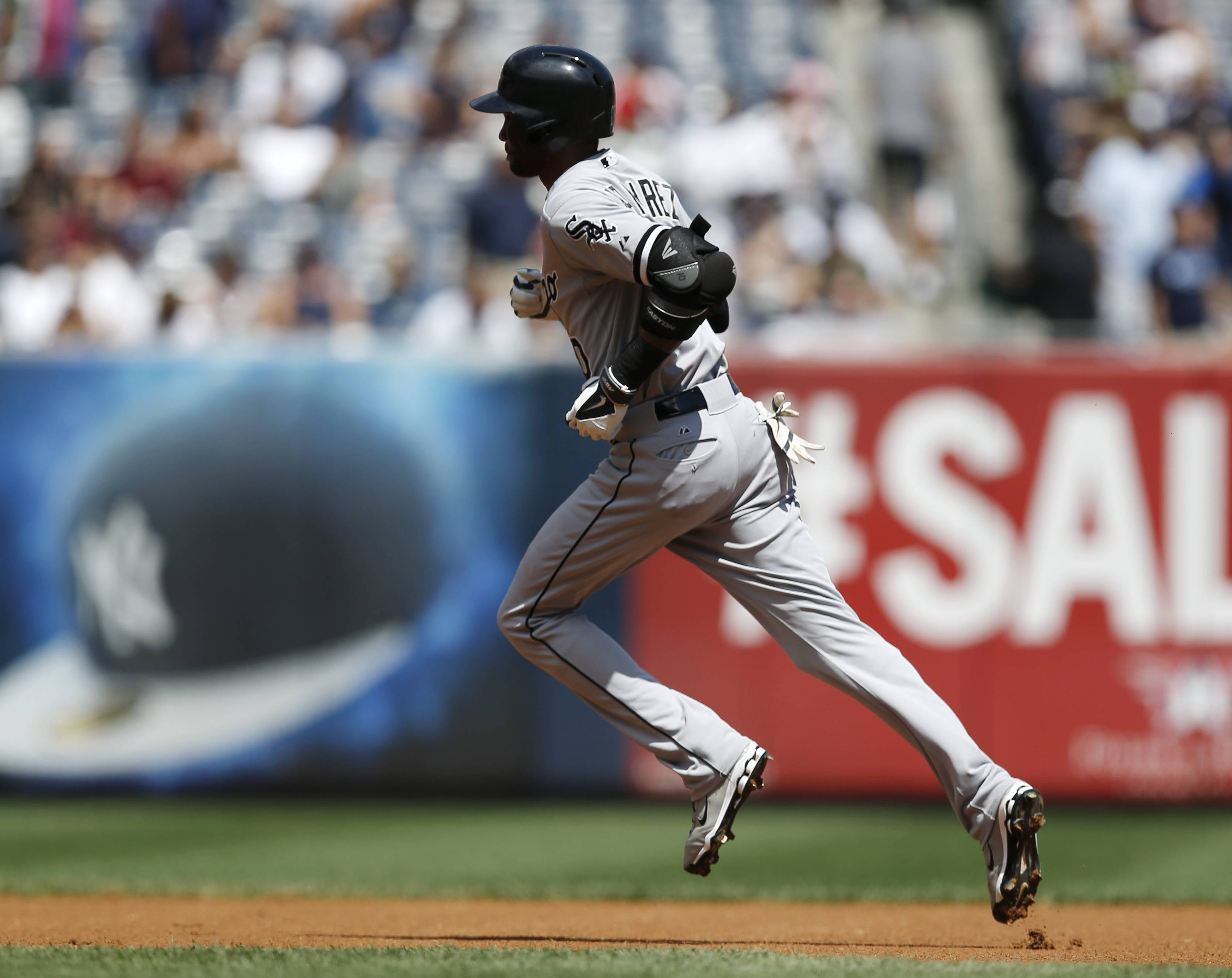 Chicago White Sox Alexei Ramirez (10) trots the bases after hitting a first-inning, solo home run in a baseball game against the New York Yankees at Yankee Stadium in New York.