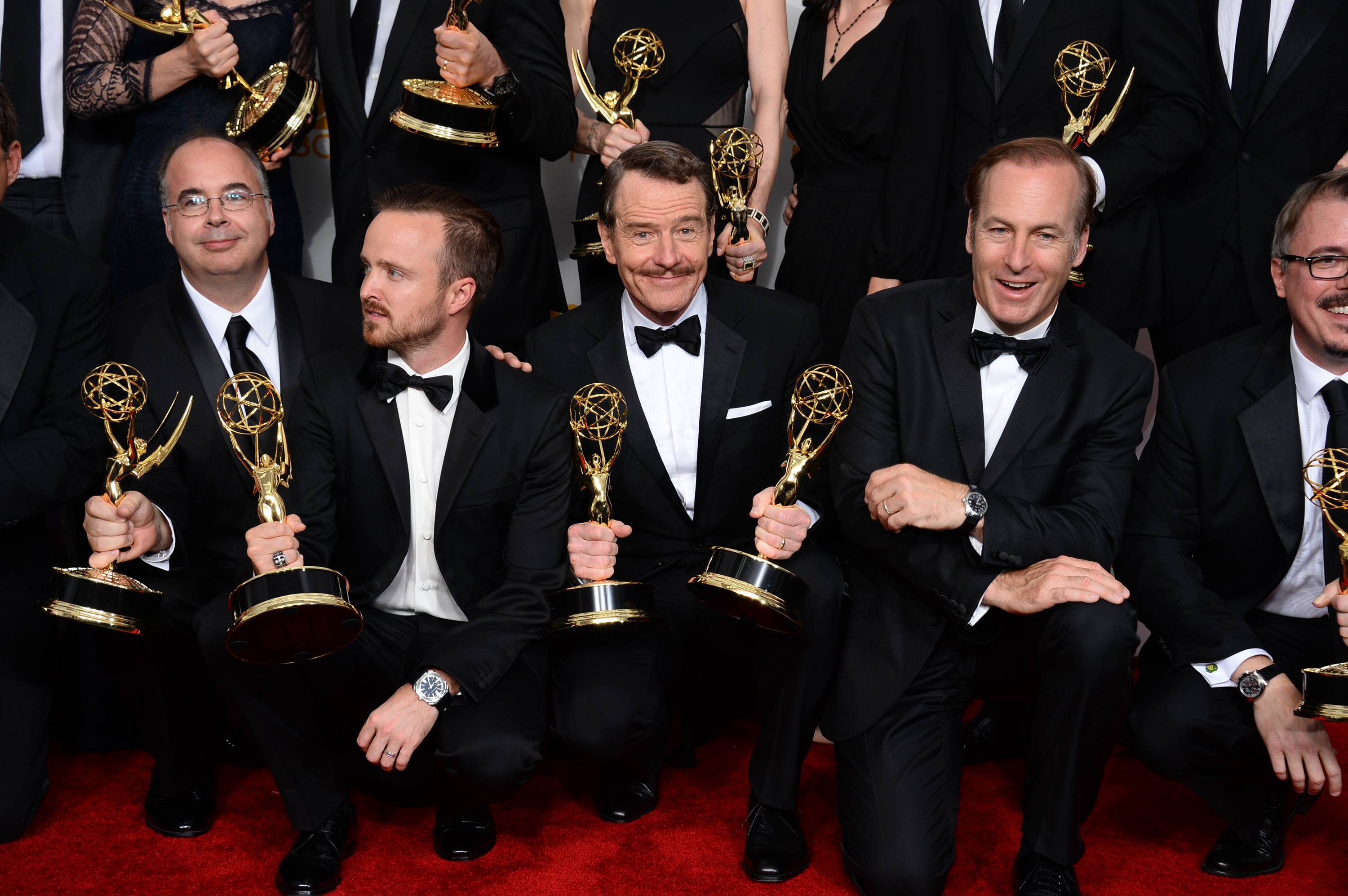 "Co-executive producer Thomas Schnauz, from left, Aaron Paul, Bryan Cranston and Bob Odenkirk pose in the press room with the award for outstanding drama series for ""Breaking Bad"" at the 66th Annual Primetime Emmy Awards at the Nokia Theatre in Los Angeles."