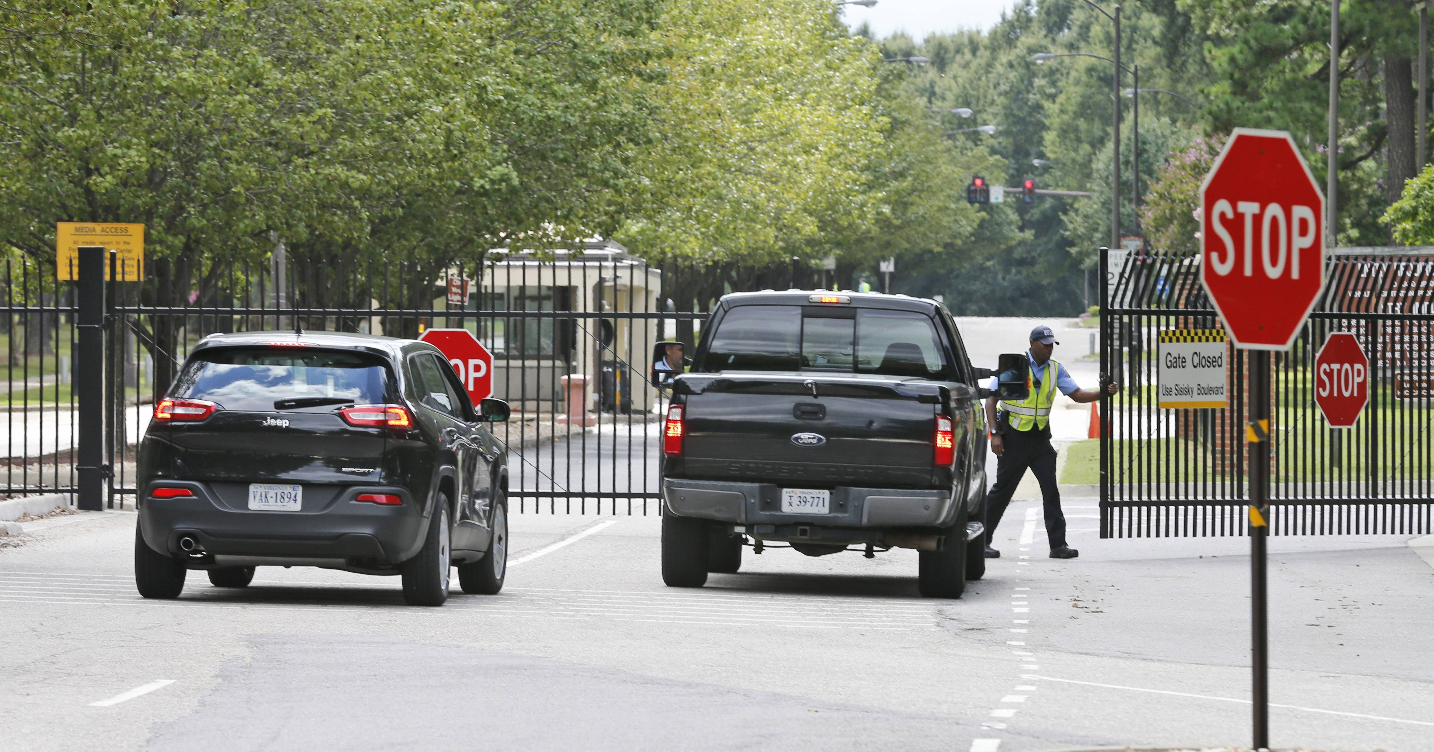 Security guards at the visitor entrance to Fort Lee, Va. A female soldier with a gun inside a key building at a Virginia Army base turned the weapon on herself and killed herself, but didn't wound any others as the heavily trafficked base temporarily went on lockdown Monday morning.