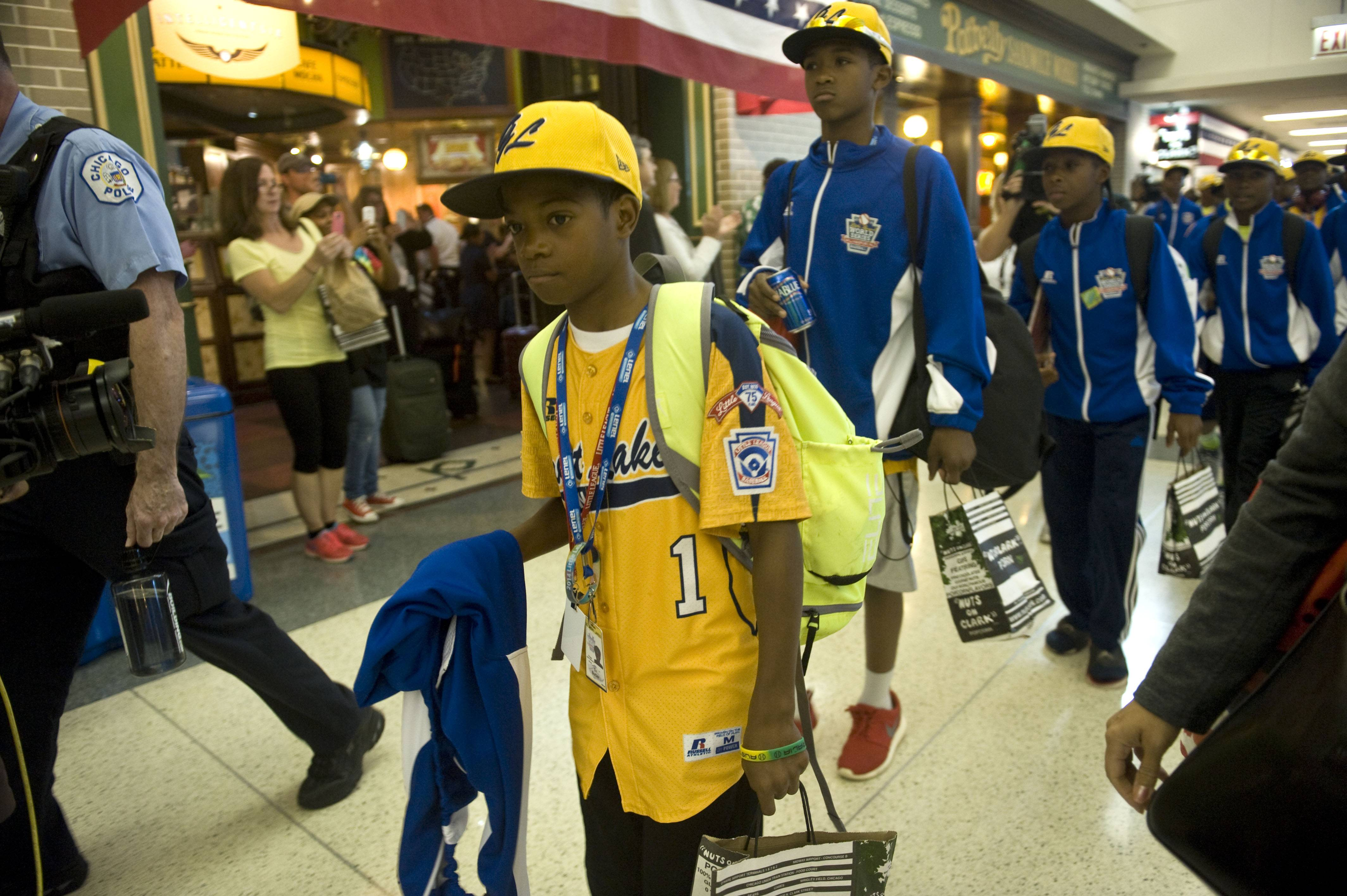 The Jackie Robinson West All Stars Little League team arrives back home to Chicago on Monday.