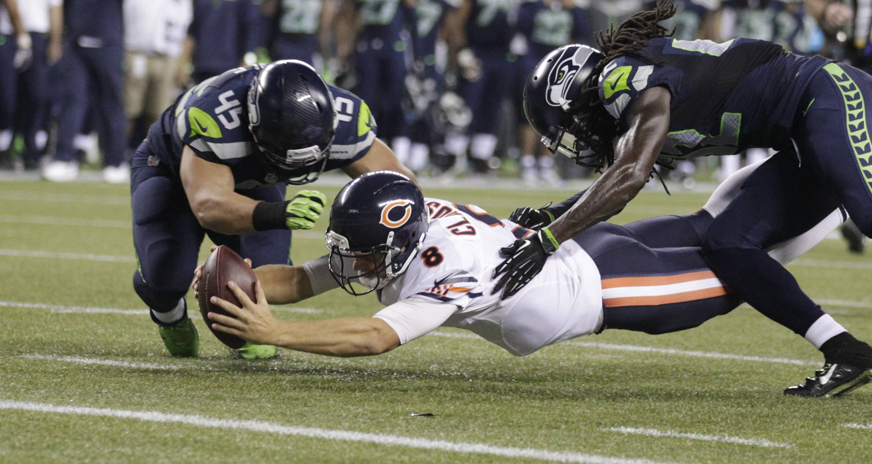 Bears quarterback Jimmy Clausen, falling just short of the goal line in Friday's loss at Seattle, came up the winner in the battle to back up Jay Cutler.
