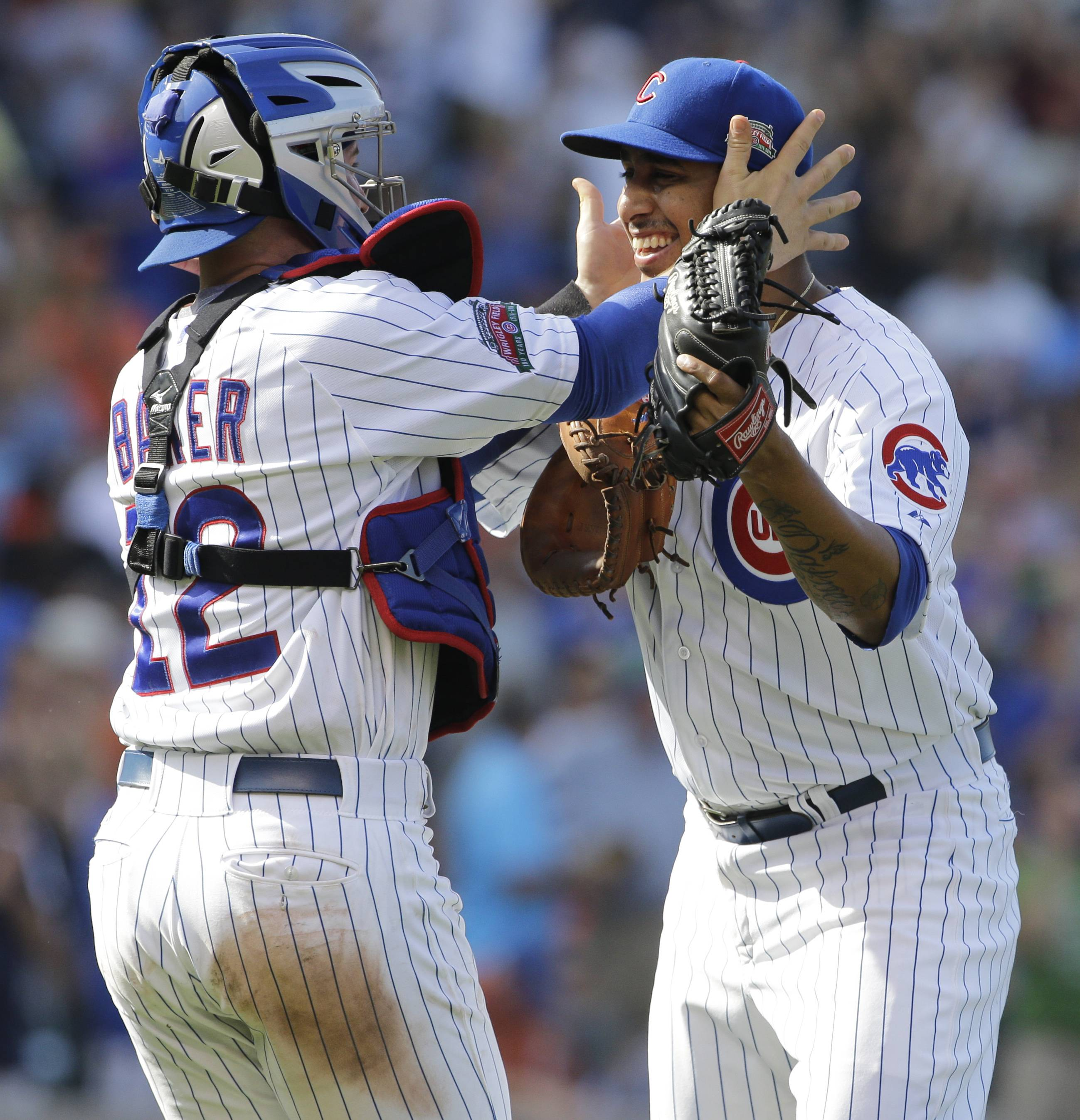 Cubs relief pitcher Hector Rondon celebrates with catcher John Baker after the Cubs defeated the Baltimore Orioles 4-1 on Friday.
