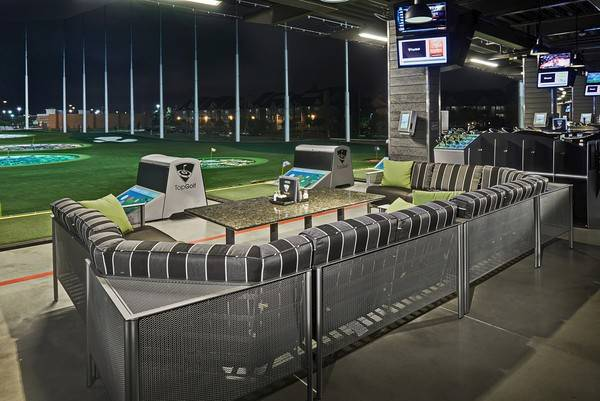 The hitting bay is the Topgolf equivalent of a bowling lane, and a new golf entertainment complex the company is building in Naperville will offer 102 bays on three floors.
