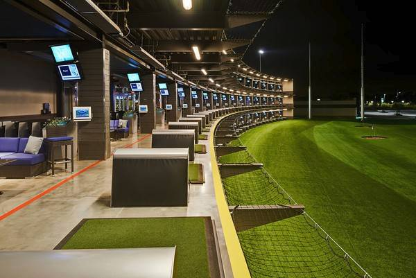 Players at the new Topgolf location in Naperville will hit microchipped balls from rows of hitting bays onto a range with holes that look like targets on a dart board. A variety of games count how many points players score based on how close their hits land to the holes.