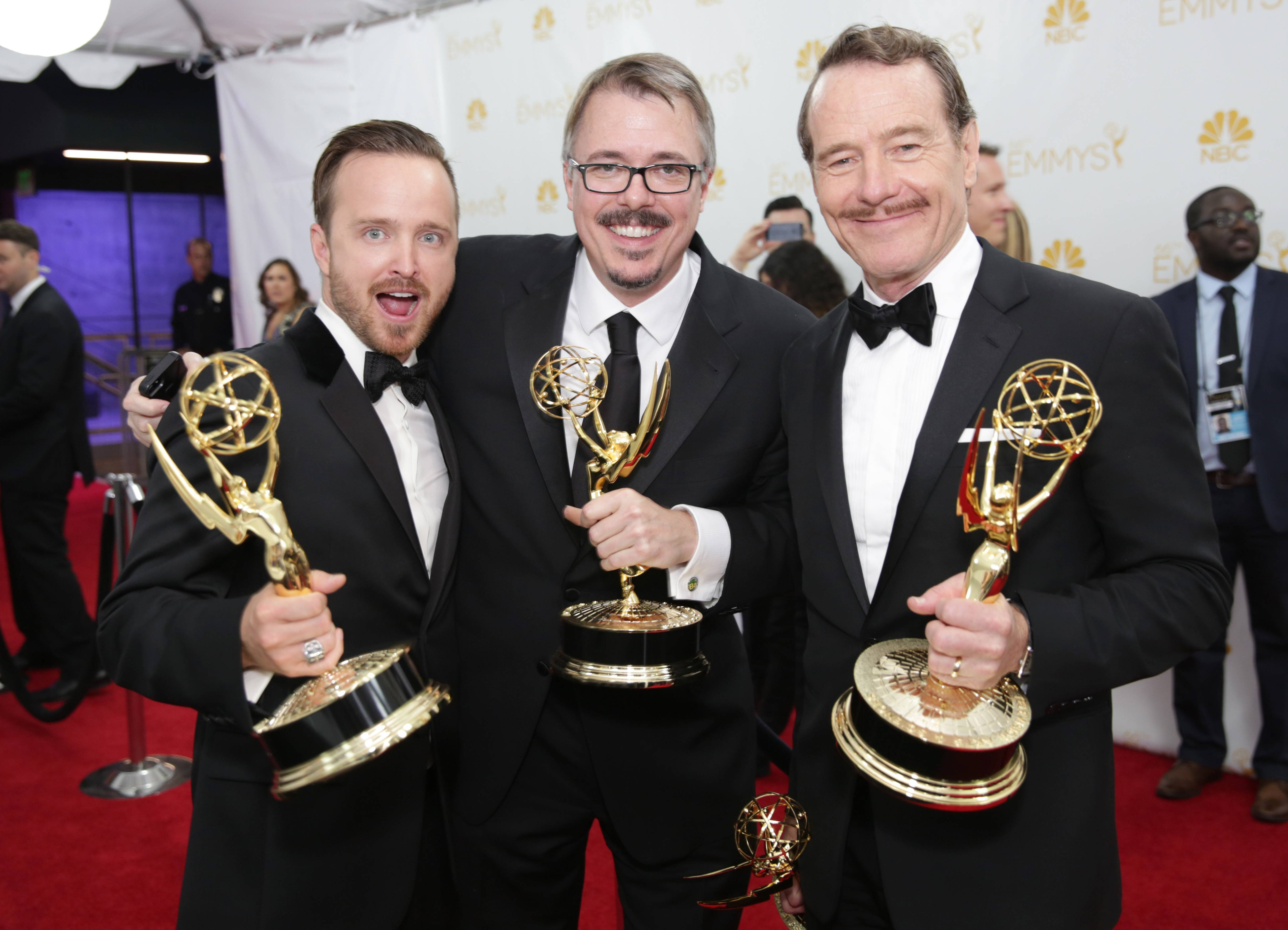 Aaron Paul, left, Vince Gilligan and Bryan Cranston pose at the 66th Primetime Emmy Awards at the Nokia Theatre.