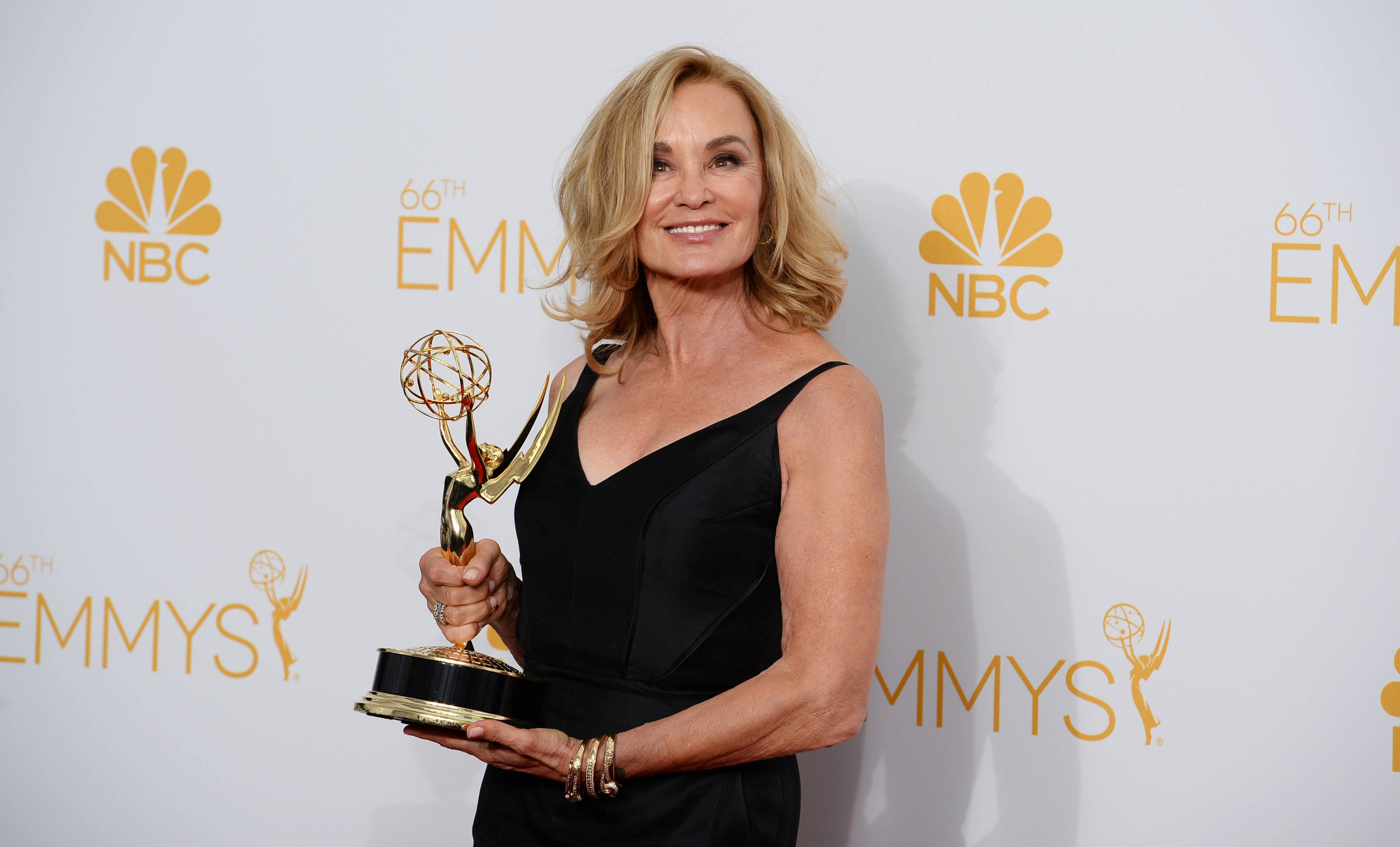 Jessica Lange poses in the press room at the 66th Annual Primetime Emmy Awards at the Nokia Theatre in Los Angeles.