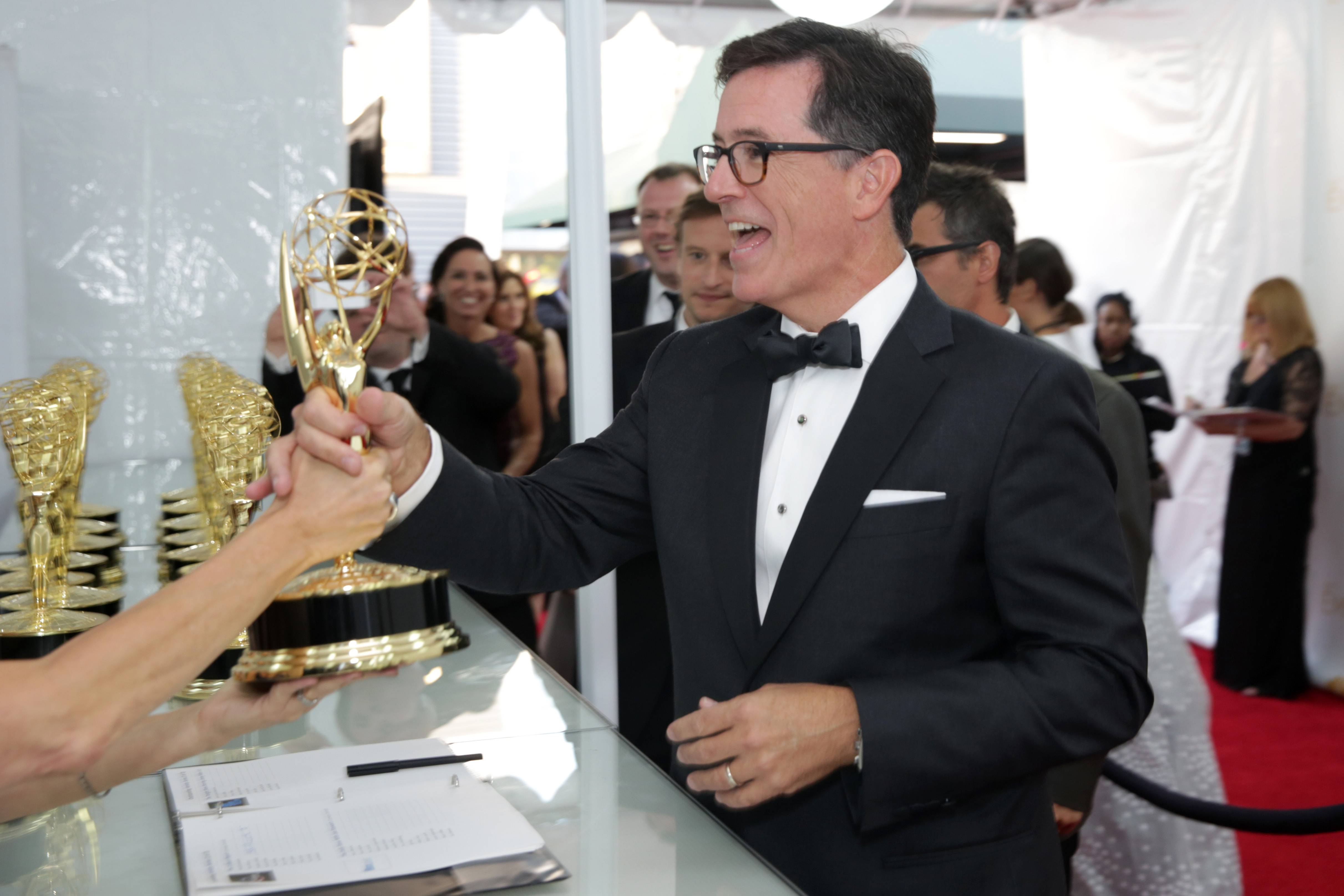 Stephen Colbert poses with the award for Outstanding Variety Series.
